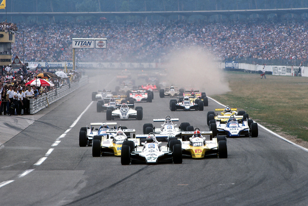 Alan Jones in his Williams FW07B, leads into the first corner at the start of the race.