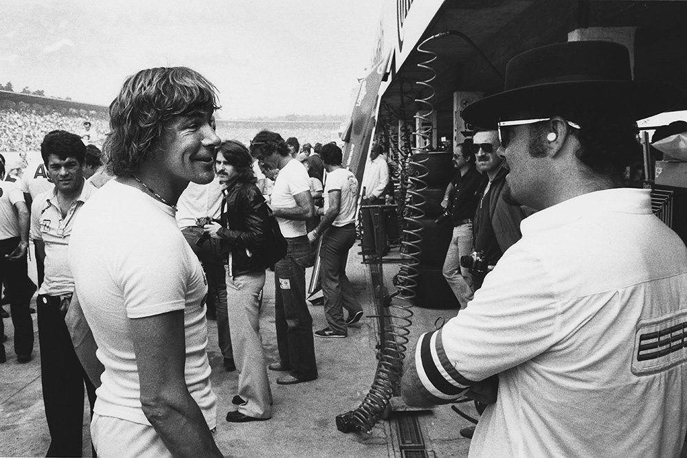 James Hunt shares a joke with a Lotus mechanic.