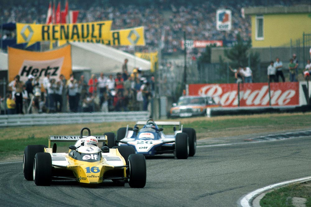 Rene Arnoux in a Renault RE20, leads eventual winner Jacques Laffite in his Ligier JS11/15.
