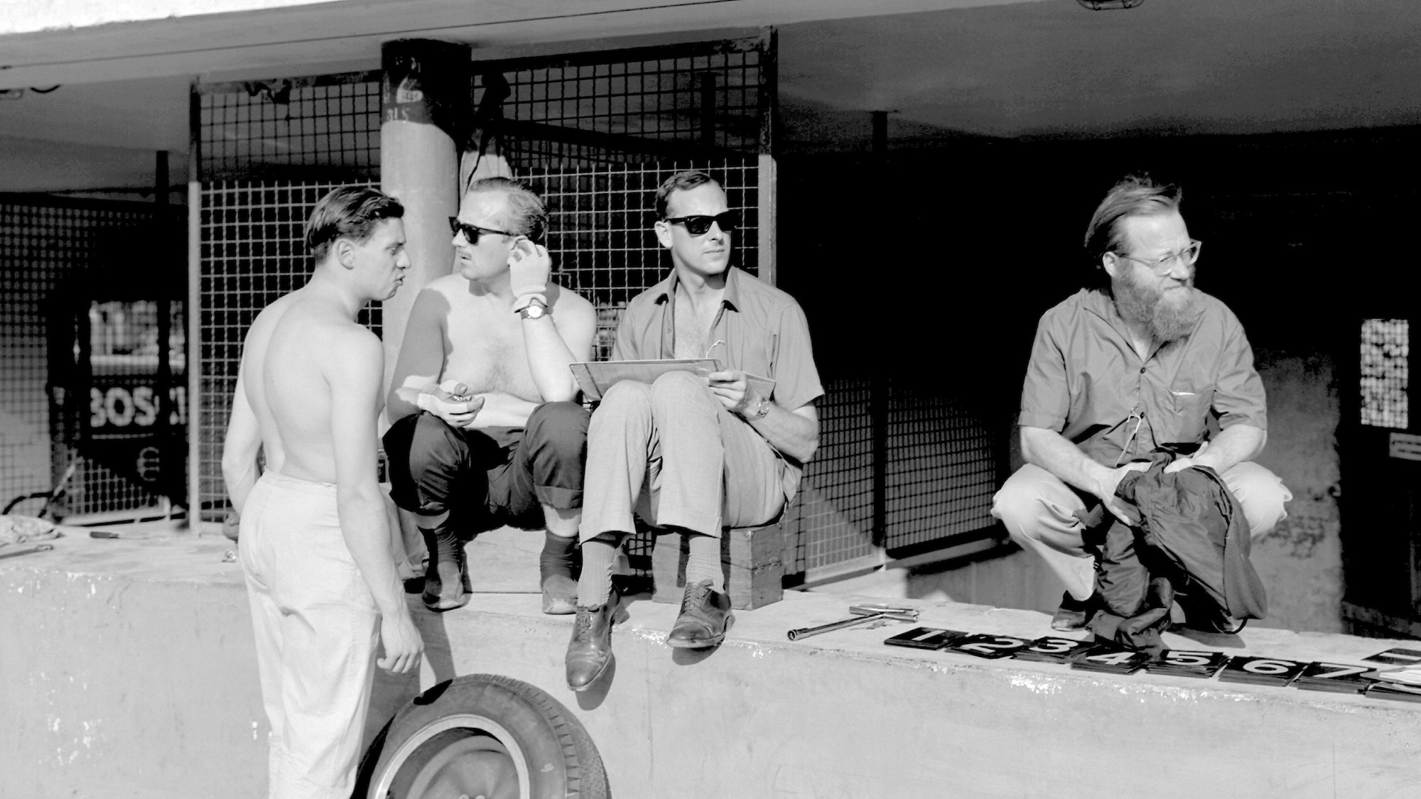 Denis Jenkinson with Jim Clark and Colin Chapman in the Monza pitlane in 1963
