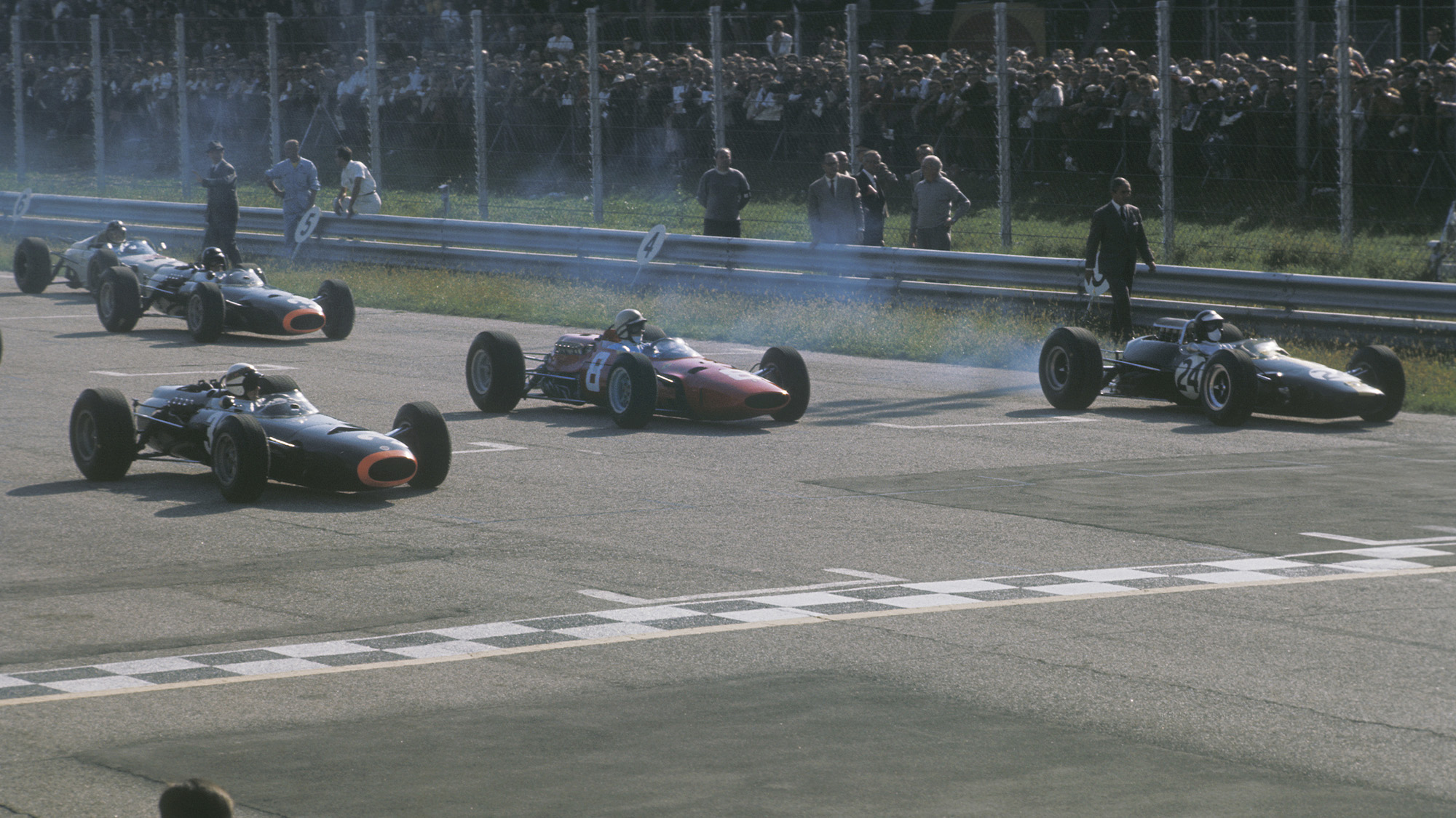 Jackie Stewart, John Surtees and Jim Clark on the front row at Monza for the start of the 1965 Italian Grand Prix