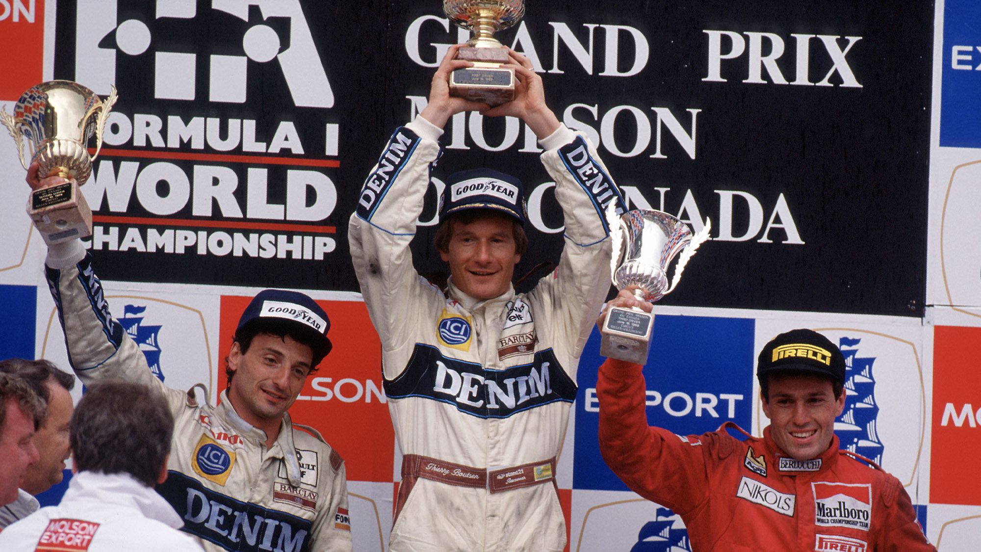 Thierry Boutsen on the podium alongside Ricardo Patrese and Andrea de Cesaris after winning the 1989 Canadian Grand Prix at Montreal