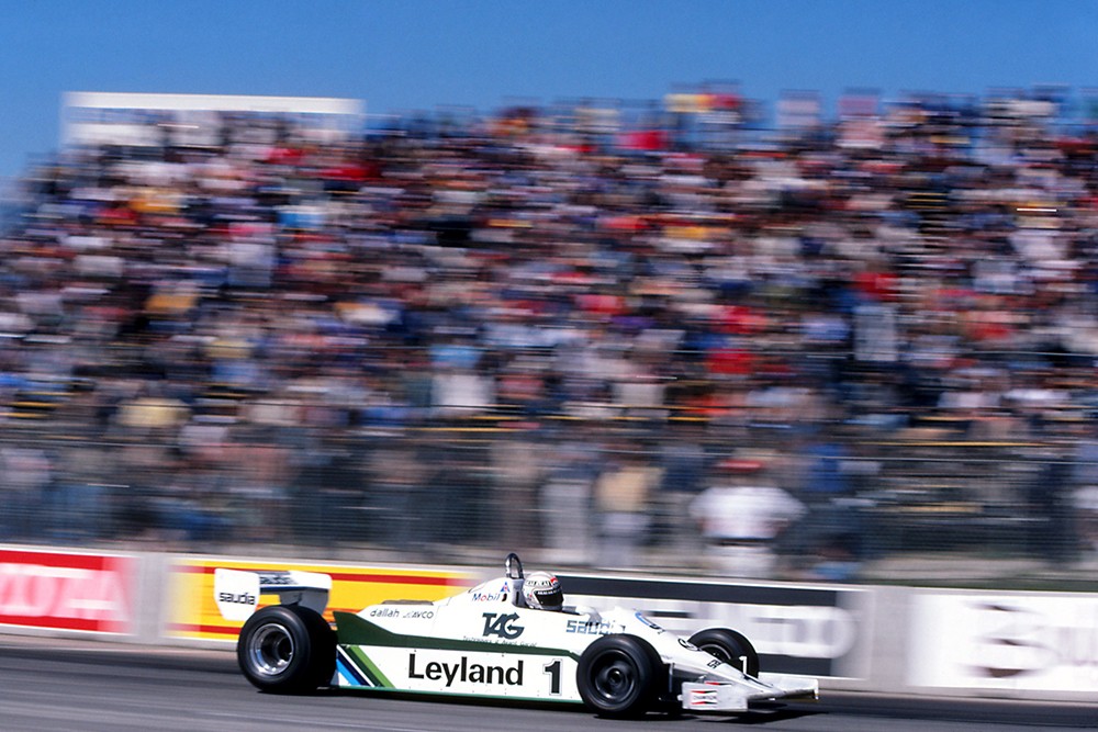 Race winner Alan Jones in a Williams FW07C.