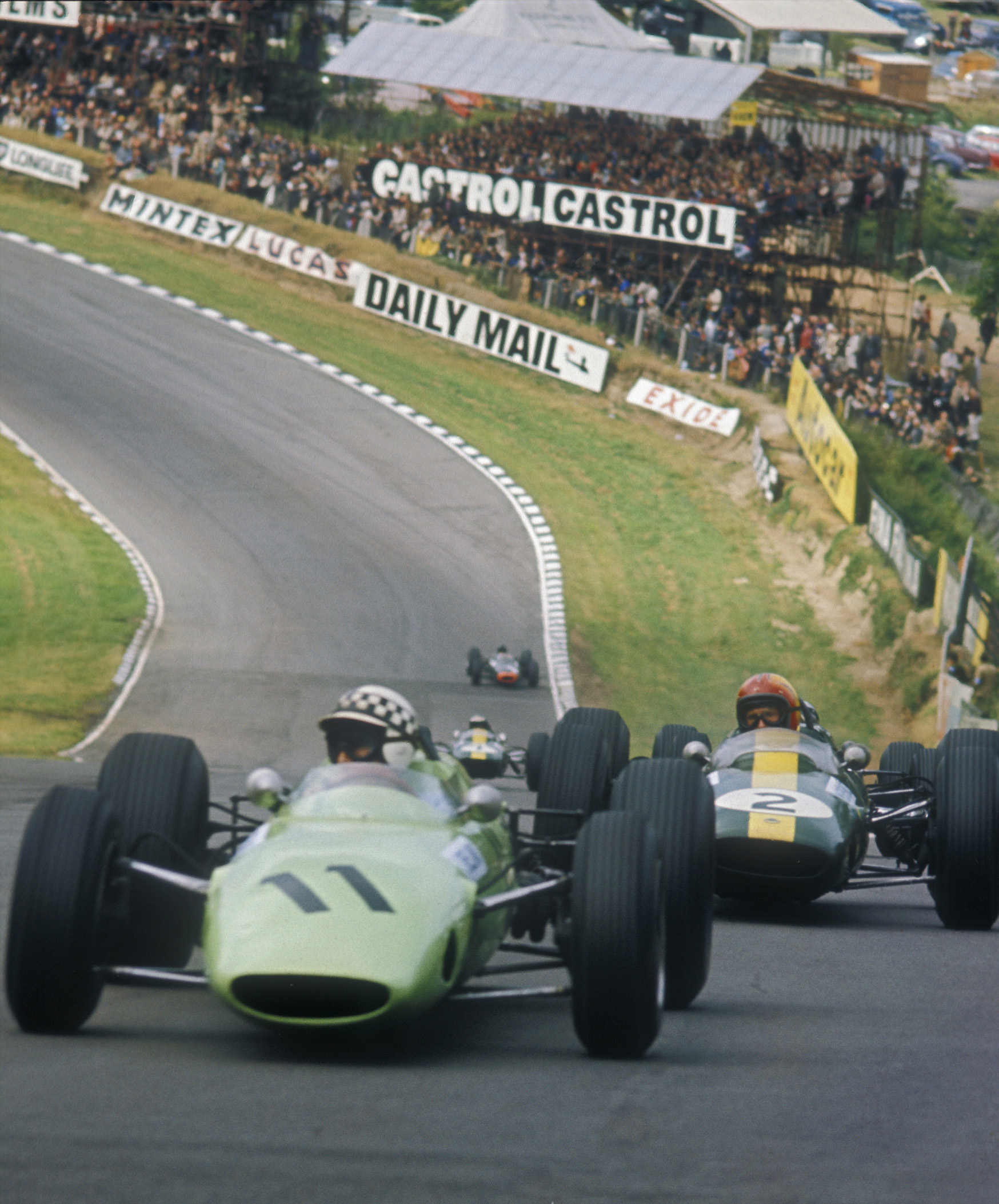Innes-Ireland-leads-Mike-Spence-at-the-1964-British-Grand-Prix-at-Brands-Hatch