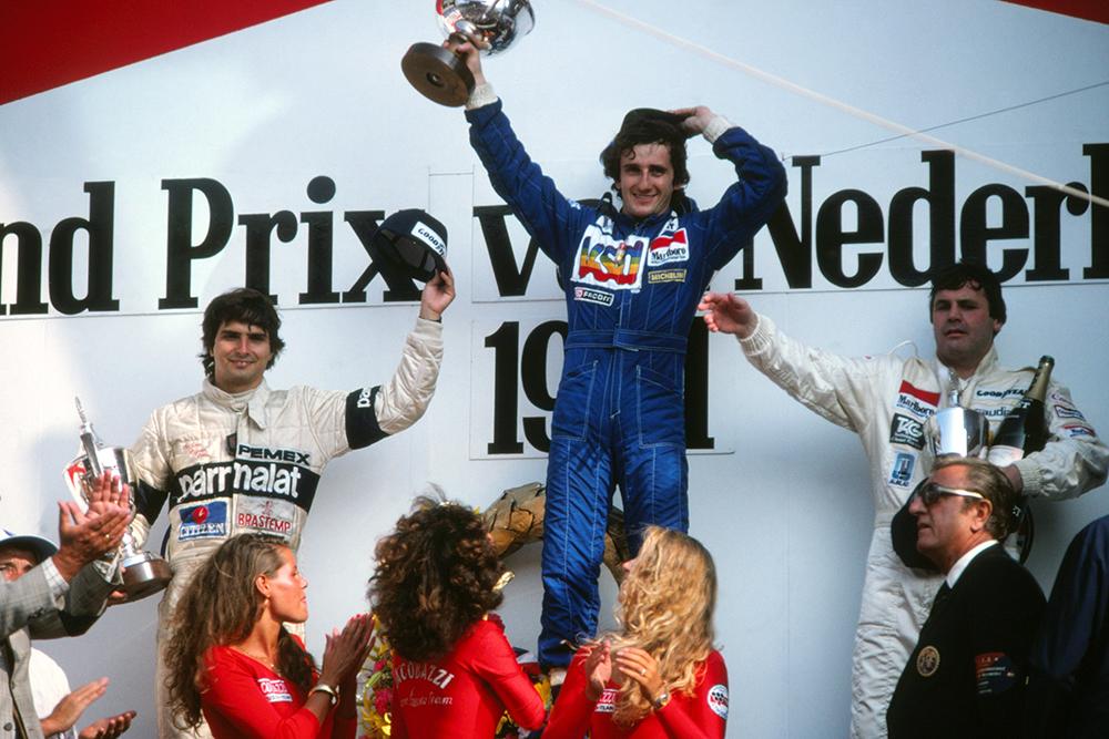 On the podium, 1st Alain Prost (Renault), 2nd Nelson Piquet (Brabham), left.3rd Alan Jones (Williams) right.