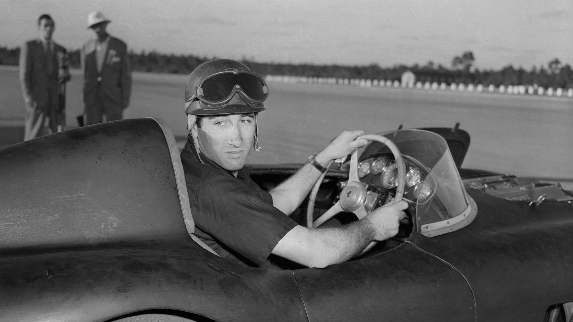 Original Caption) The Marquis de Portago of Spain sits in his three liter Ferrari after winning the 30 lap, 105 mile auto race at Windsor Field Course. The following day the Marquis placed second in the 210 mile Nassau Trophy Race, while America's Matsen Gregory of St. Louis, Mo., won; and the Baron Huschke von Hanstein of Germany came in third.