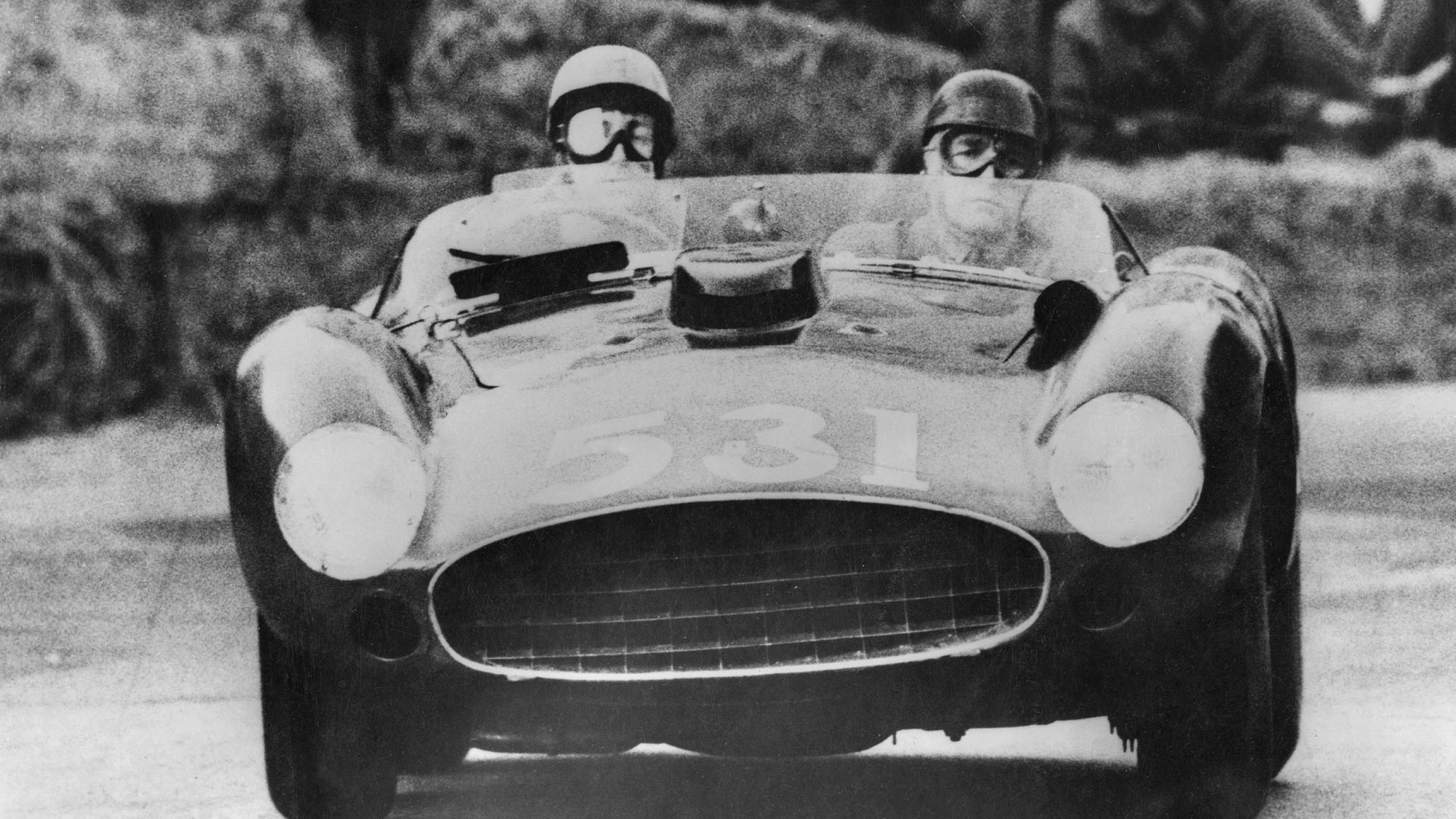 Spanish aristocrat and racing driver Alfonso de Portago, the Marquis of Portago (1928 - 1957) and his co-driver Edmund Nelson in their Ferrari at Peschiera in Italy during the Italian Mille Miglia road race, 12th May 1957. Shortly after the picture was taken, they were both killed, along with several spectators, when their car crashed into the crowd. (Photo by Keystone/Hulton Archive/Getty Images)