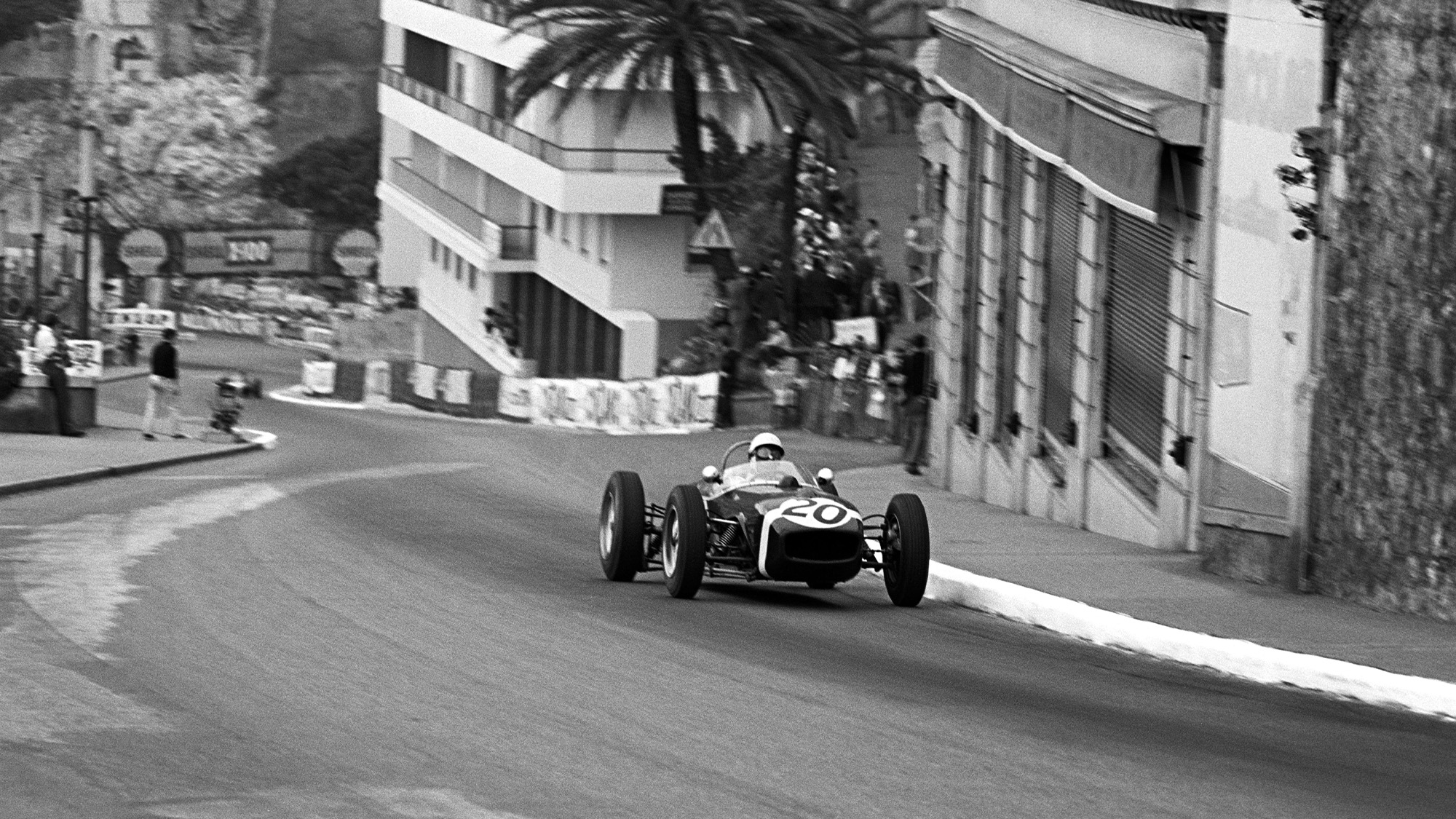Stirling Moss climbs the hill from Ste Devote in the 1961 Monaco Grand Prix