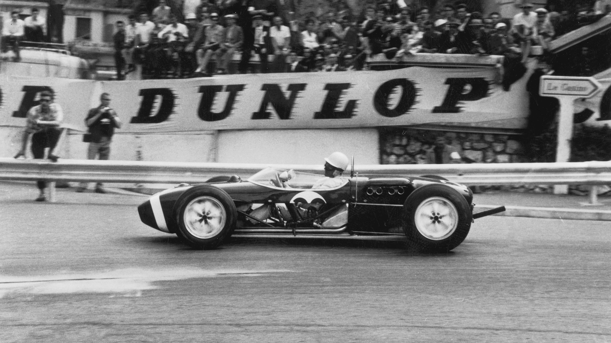Stirling Moss Lotus 18 in the 1961 Monaco Grand Prix with removed side panels