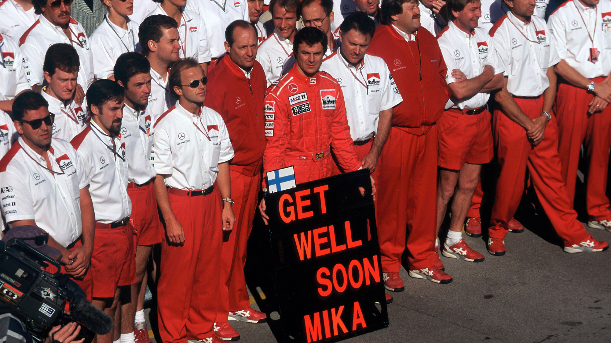 McLaren team holds a Get well soon Mika board after Hakkinen's crash in the build up to the 1995 Australian Grand Prix at Adelaide
