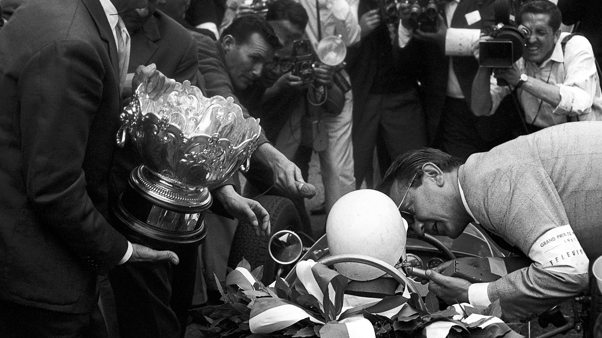 Stirling Moss in his car after winning the 1961 Monaco Grand Prix