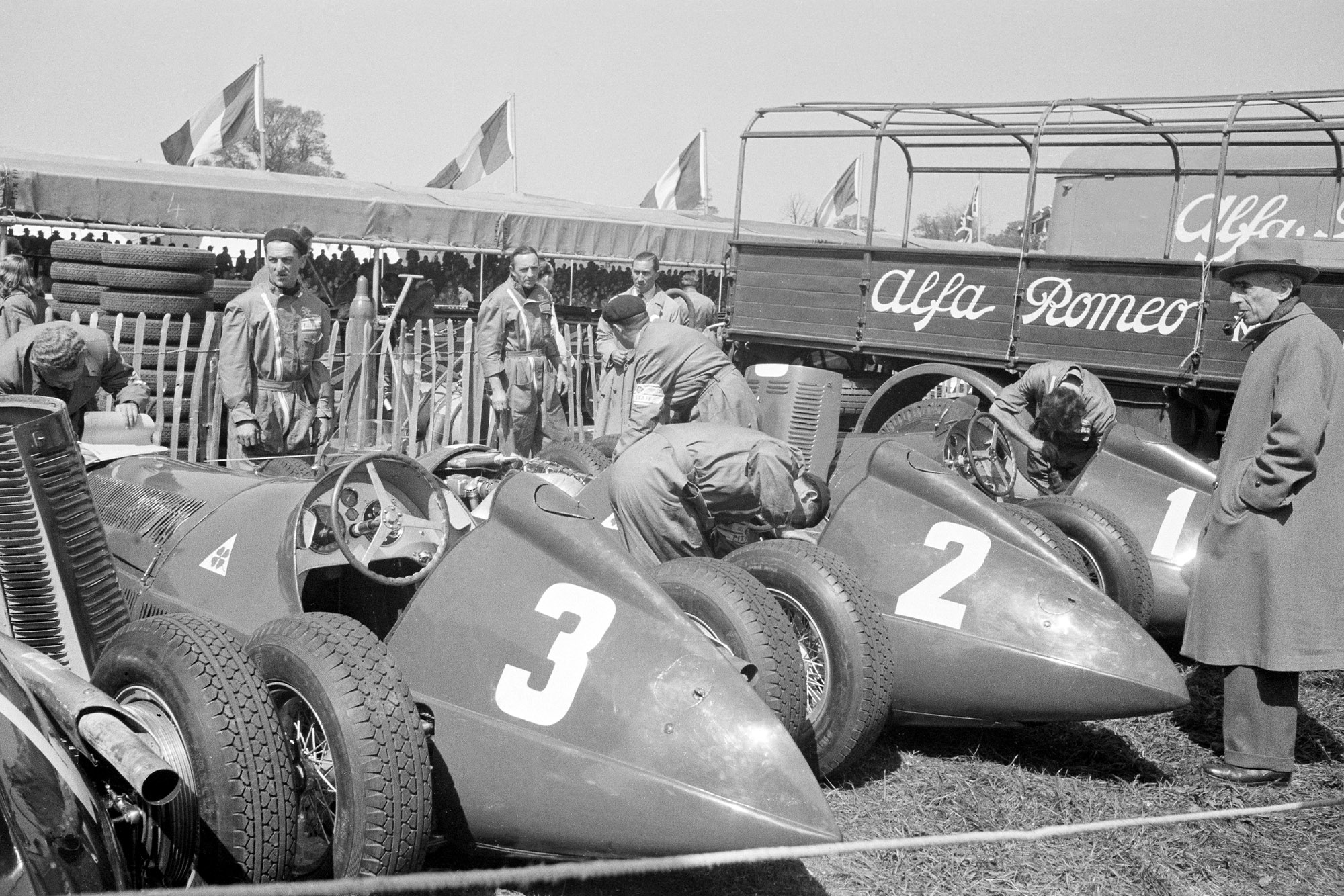 Alfa Romeo cars in the paddock ahead of the 1950 British Grand Prix