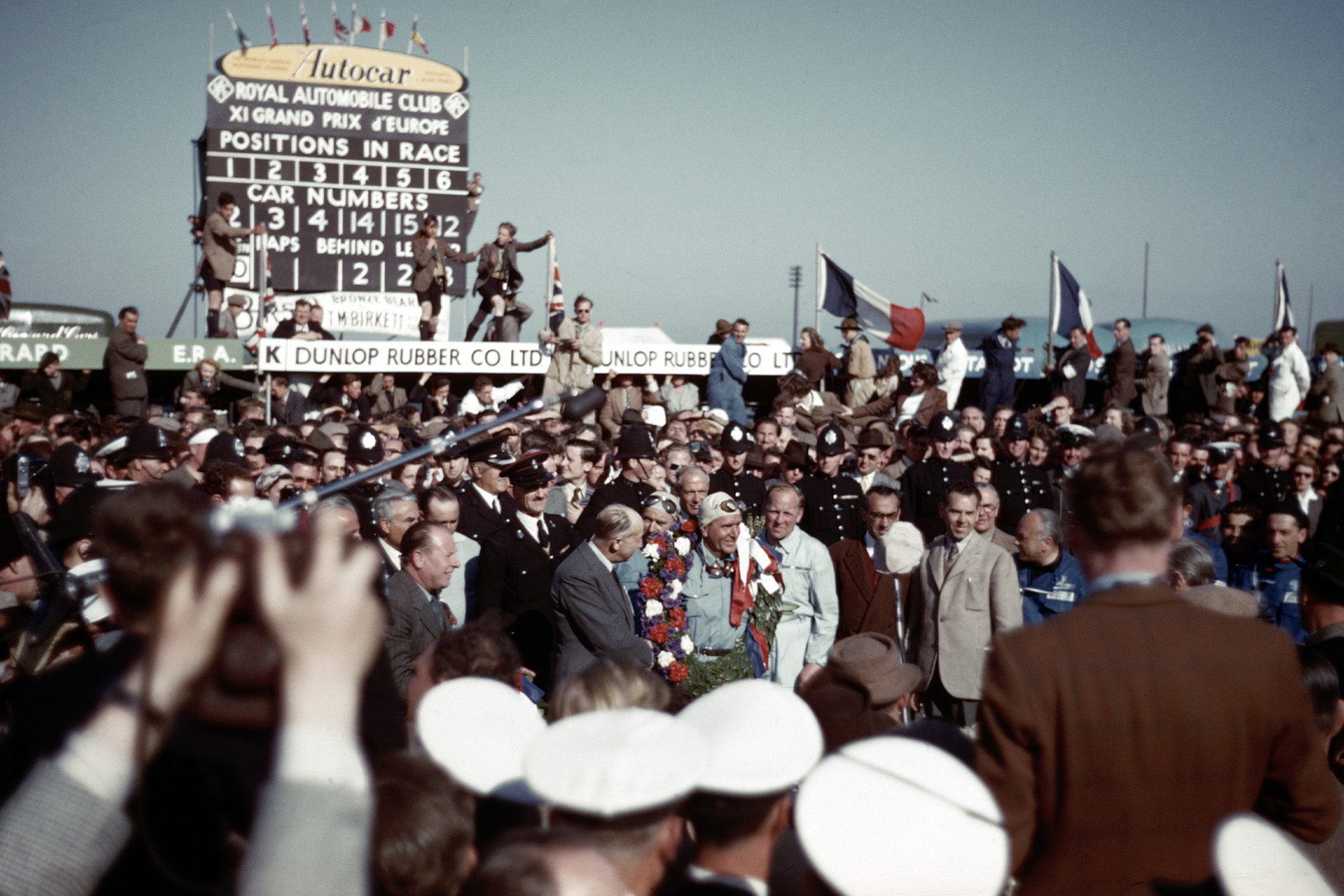 Crowds gather around Giuseppe Farina after he wins the 1950 British Grand Prix