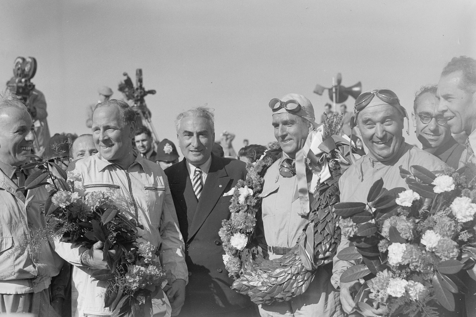 Reg Parnell, Giuseppe Farina and Luigi Fagioli - the winning ALfa Romeo team - after the 1950 British Grand Prix at Silverstone