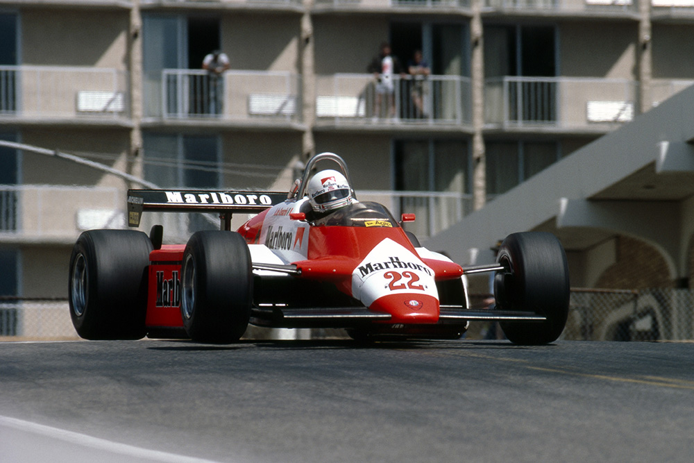 Andrea de Cesaris gets big air in his Alfa Romeo 182.