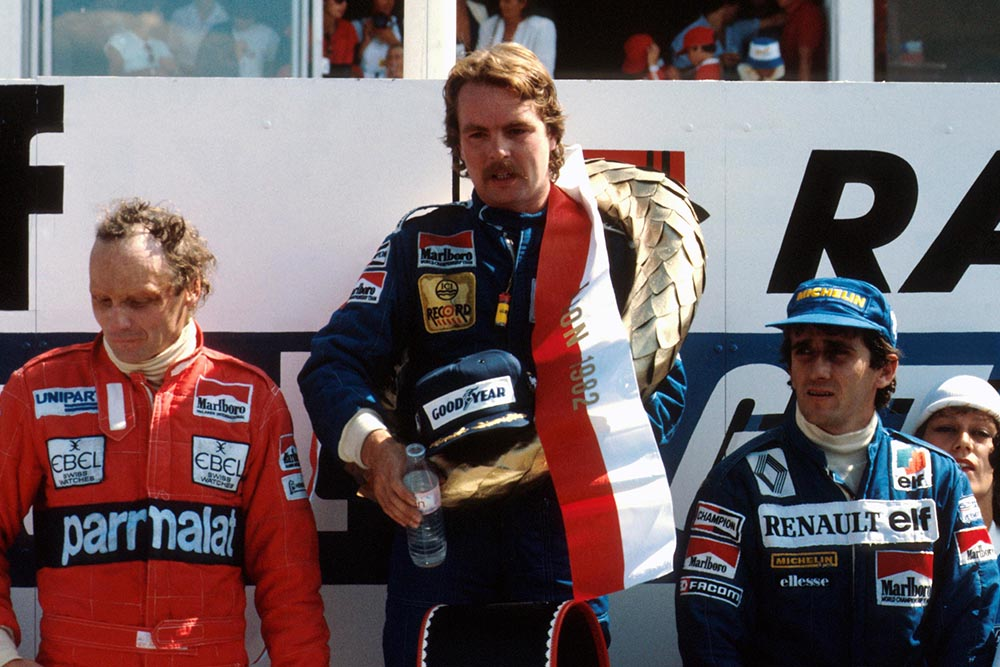 The podium (L to R): Niki Lauda (third); Keke Rosberg (first time winner) Alain Prost in second.