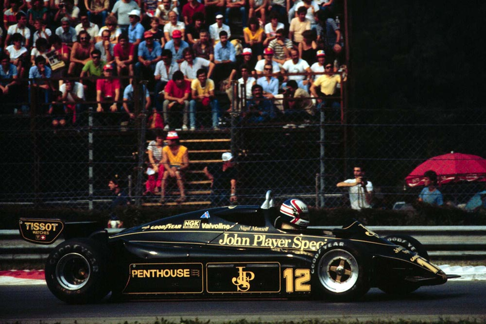 Nigel Mansell drives the JPS Lotus 91 to 7th place.