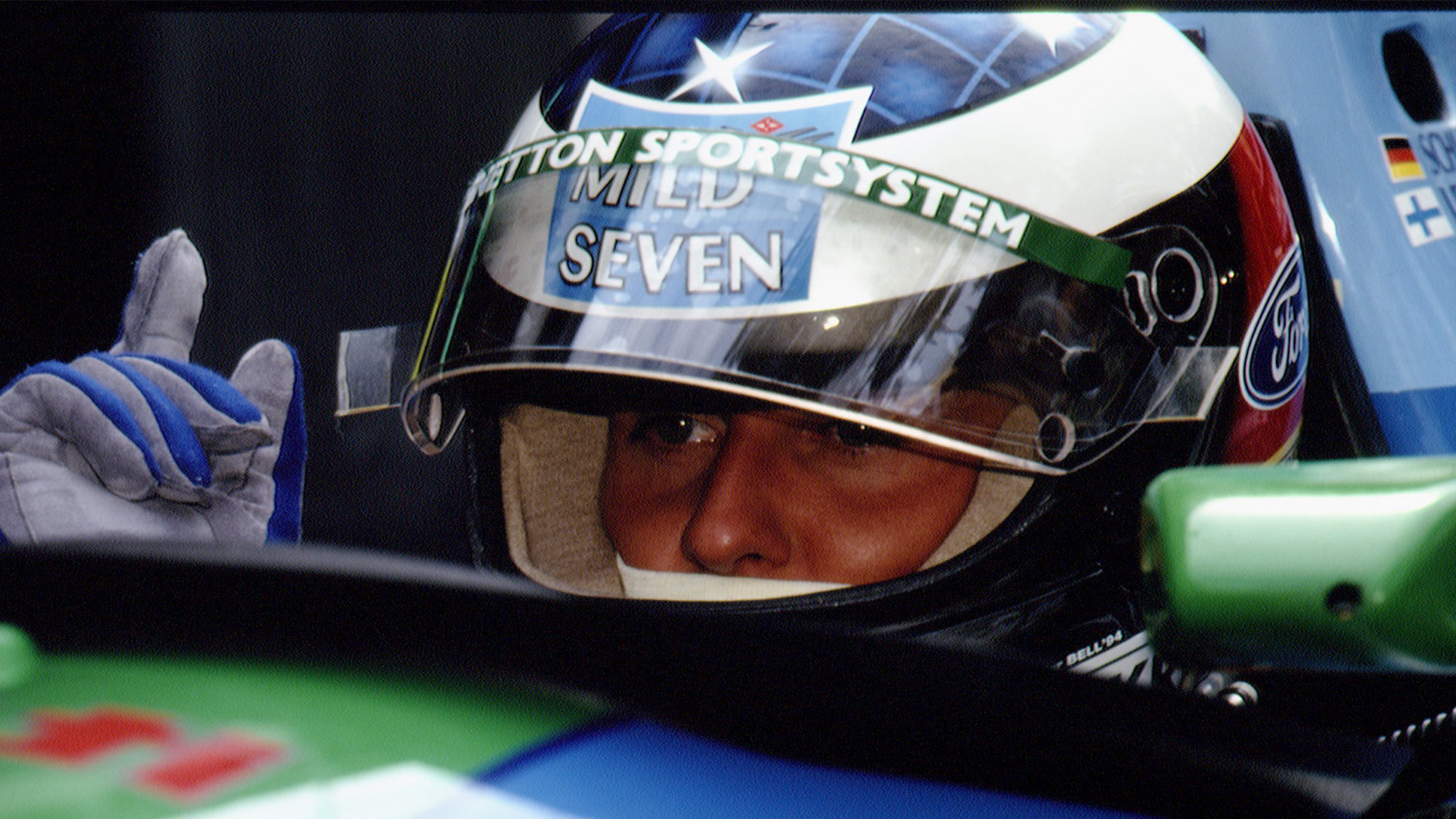 Michael Schumacher peers out from behind his helmet in the 1994 Benetton Ford