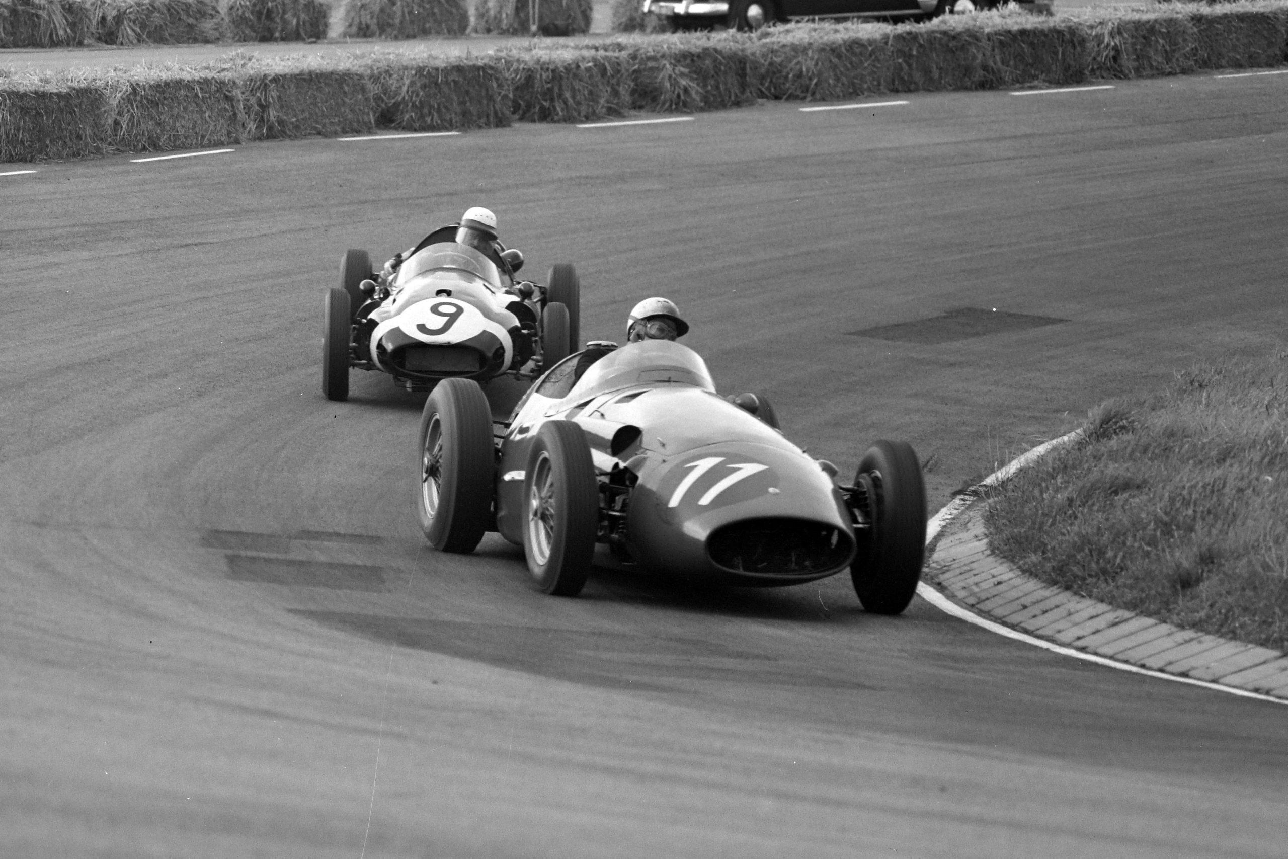 Jo Bonnier driving a Maserati 250F, leads Maurice Trintignant in his Cooper T45 Climax.