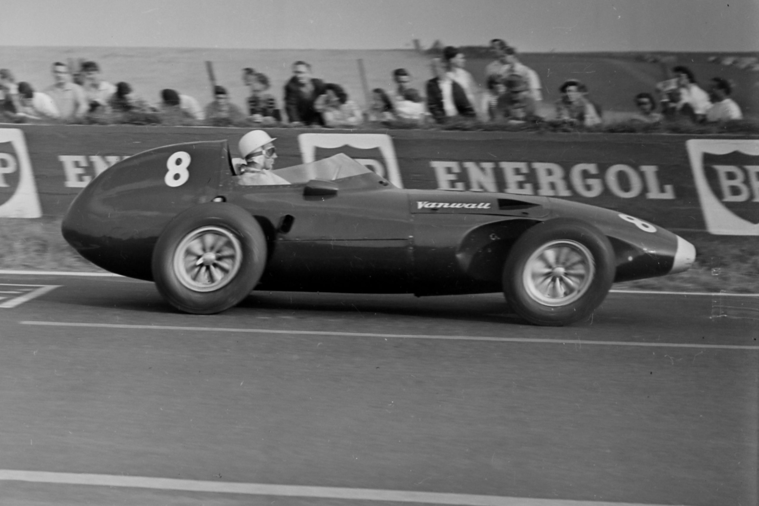 Stirling Moss blast by in a Vanwall.