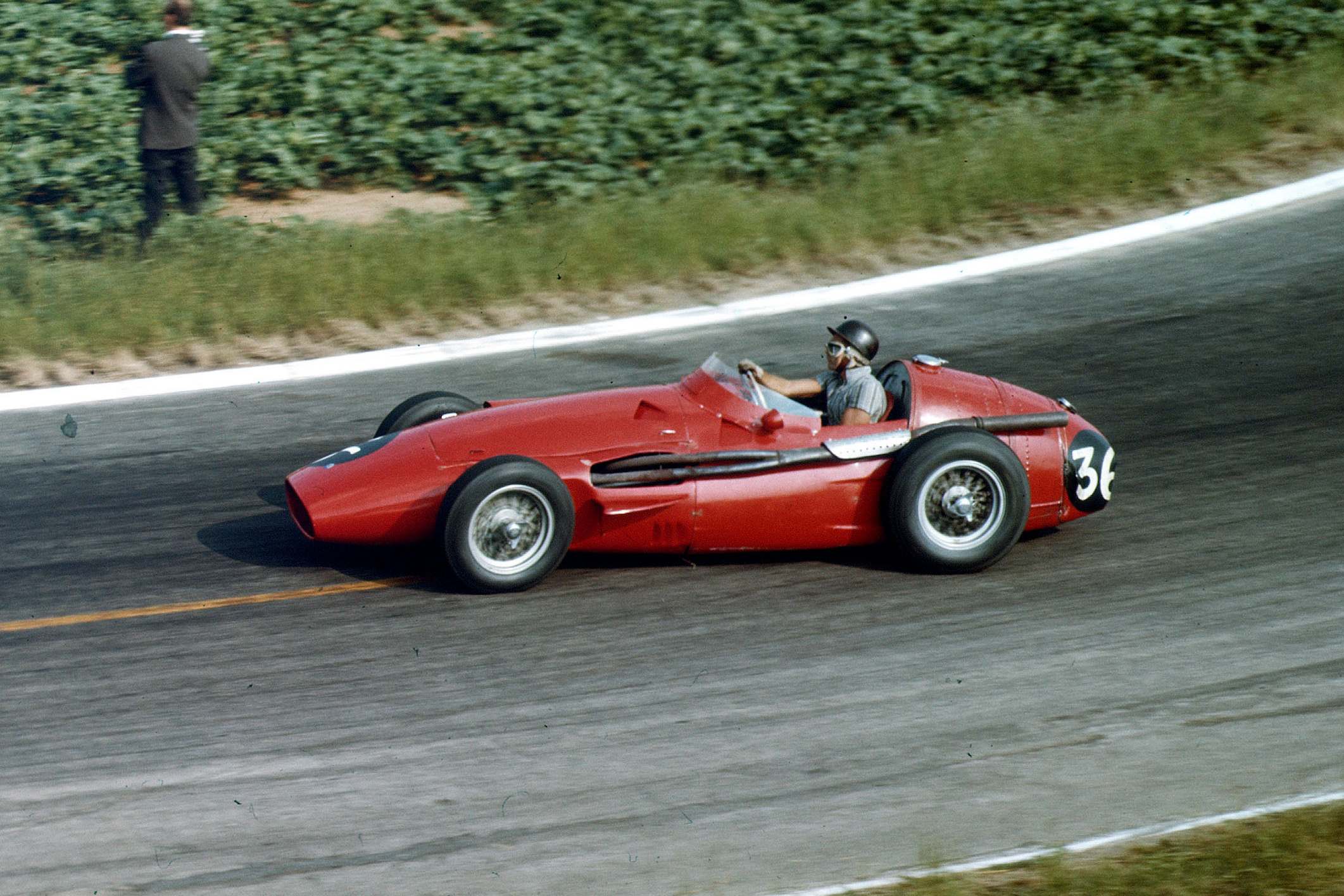 Phil Hill driving his Maserati 250F to 7th place.