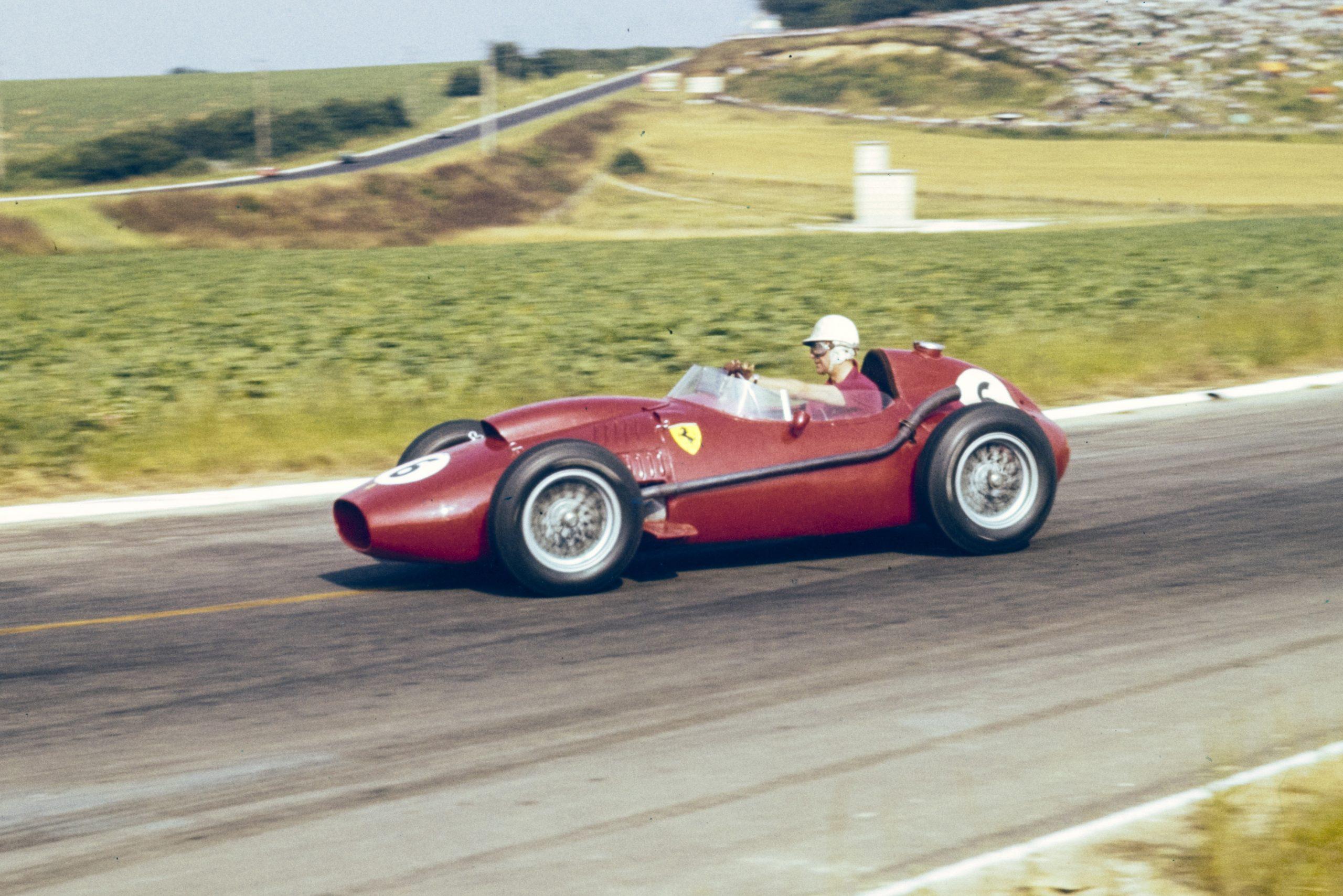 Wolfgang von Trips pilots his Ferrari 246.