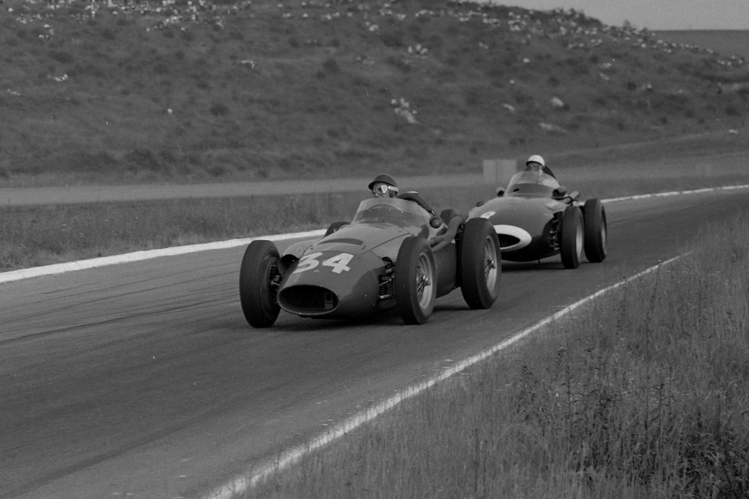 Juan Manuel Fangio in his Maserati 250F leads Stirling Moss in his Vanwall.