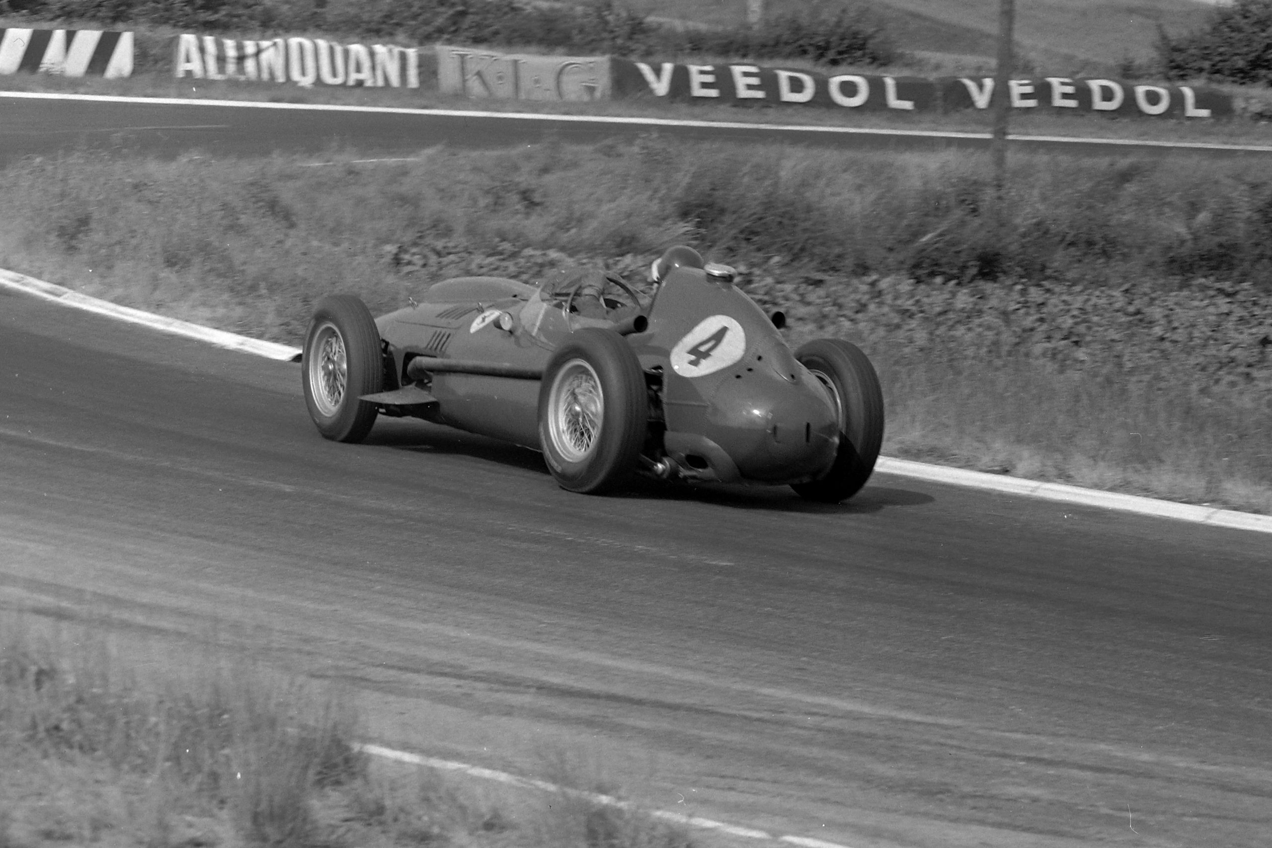 Mike Hawthorn driving his Ferrari 246.