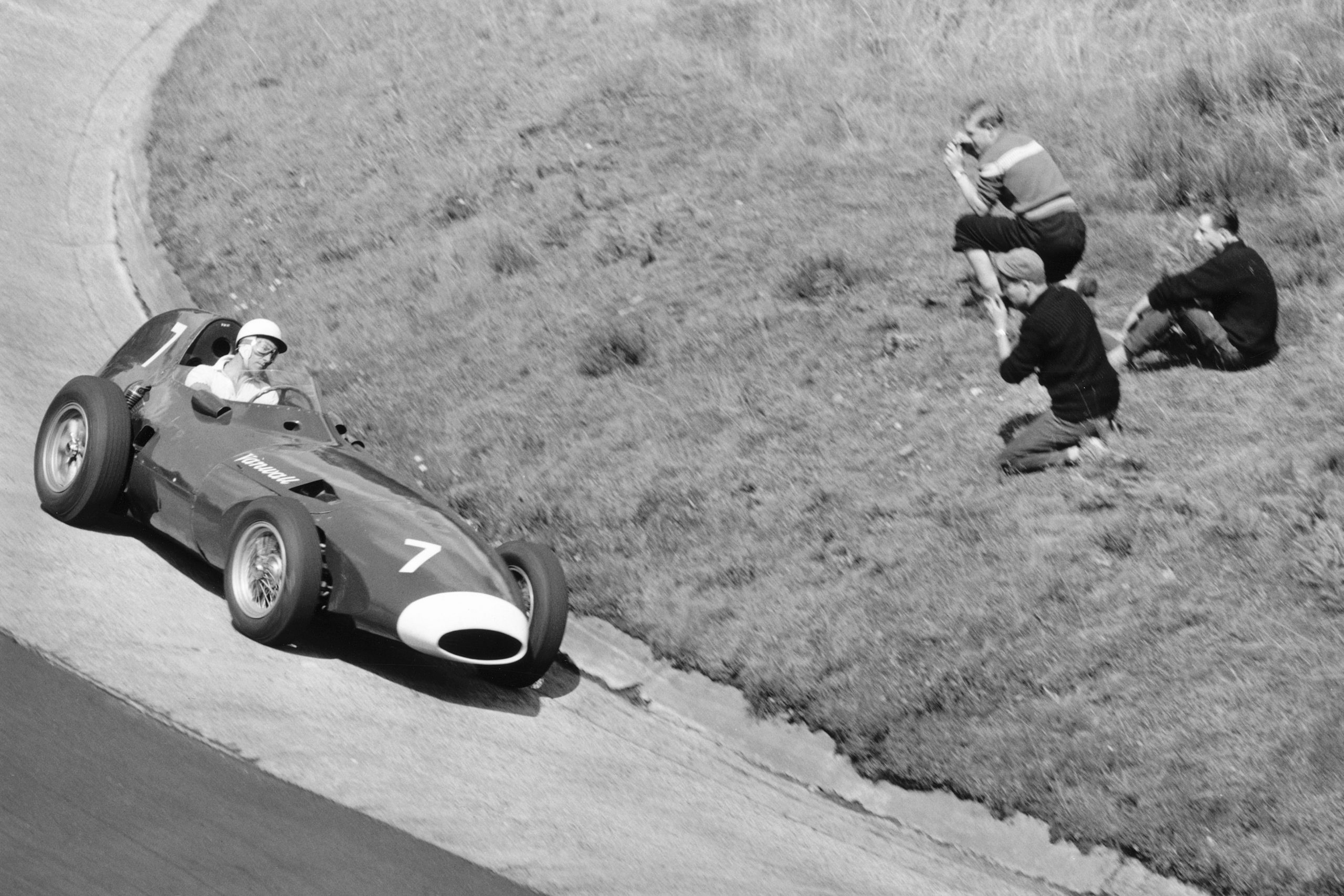 Stirling Moss takes his Vanwall around the Karussel.