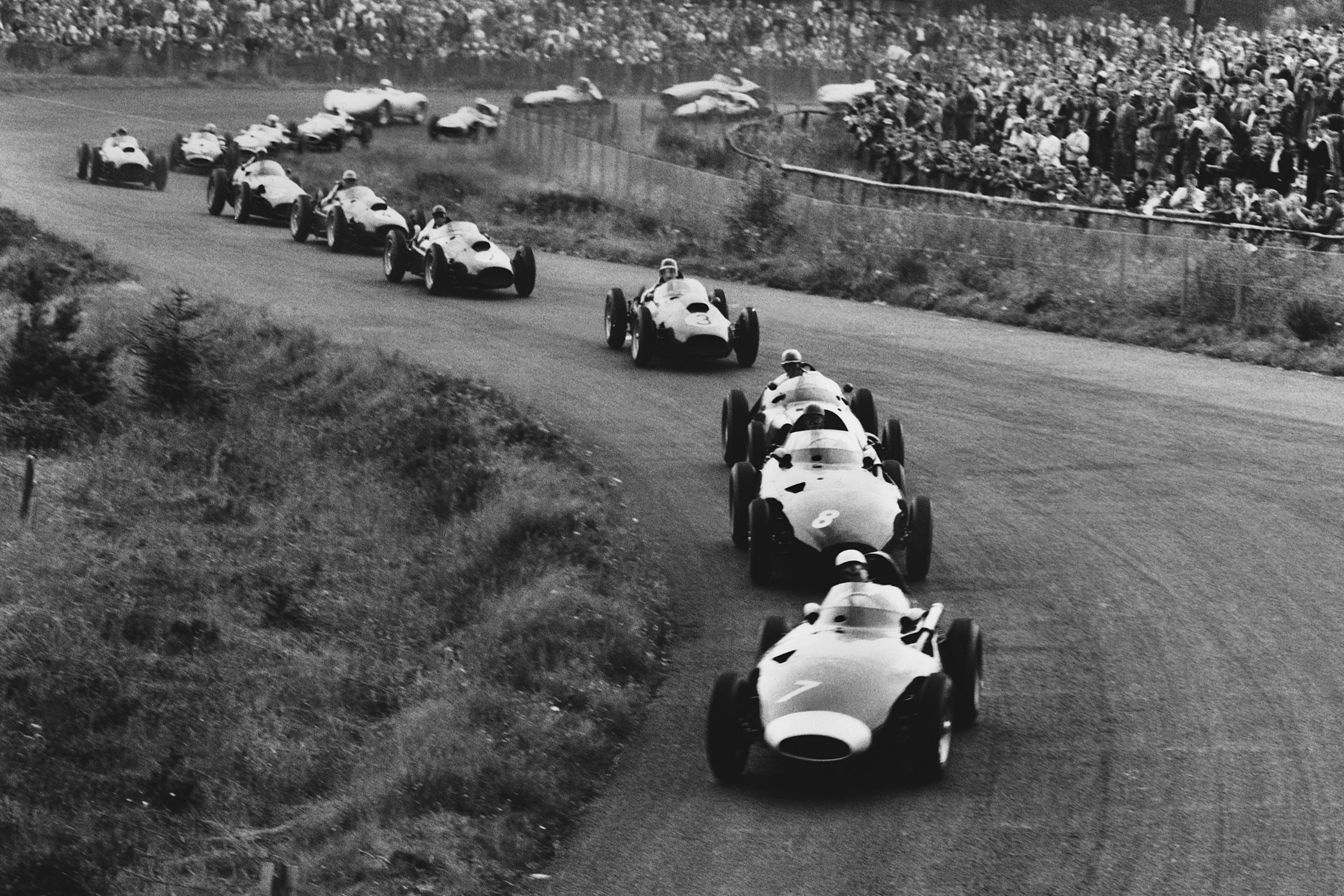 Stirling Moss driving a Vanwall leads Tony Brooks also in a Vanwall at the start of the race.