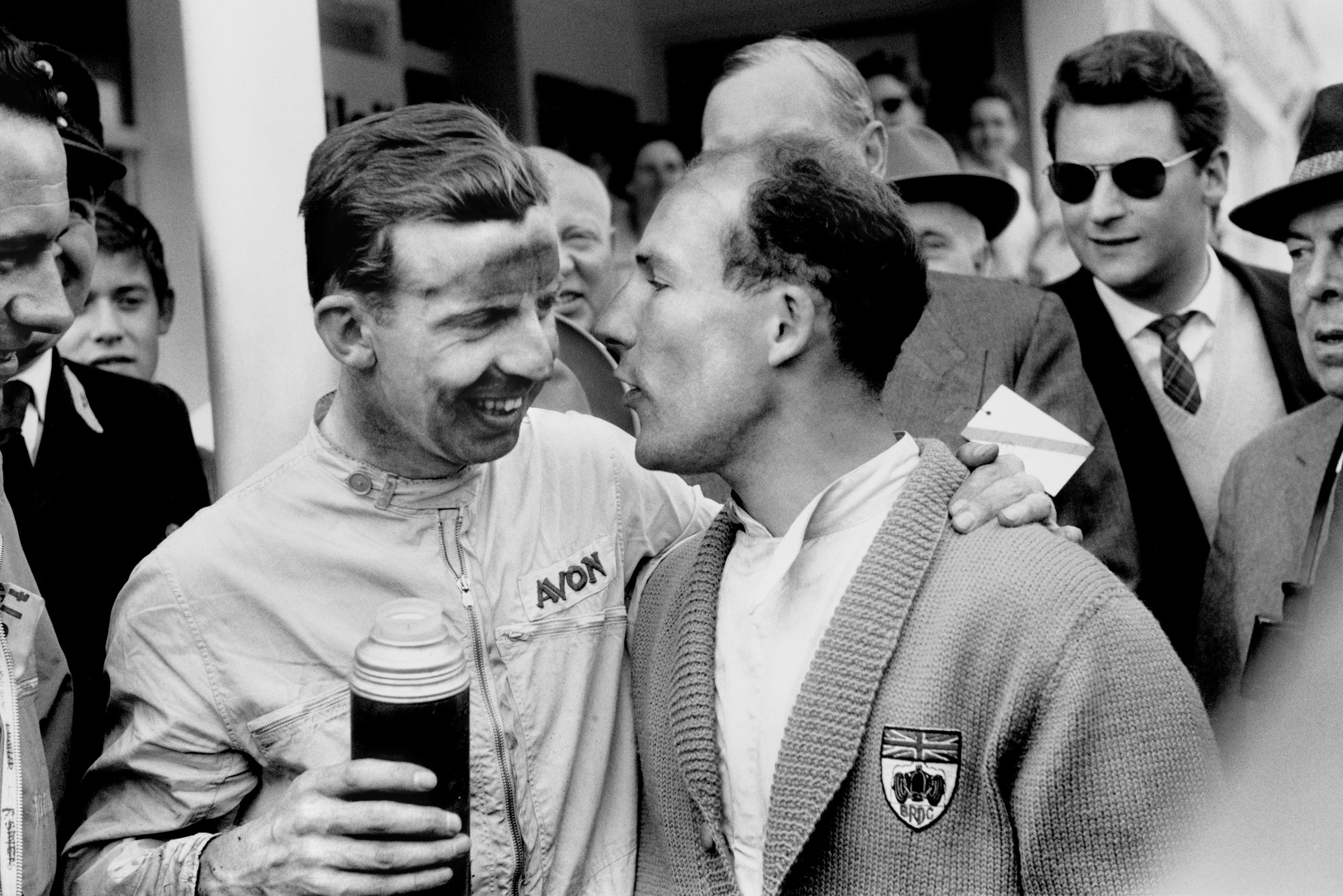 Winner Tony Brooks drinks from a flask with Vanwall team mate Stirling Moss who retired from the race.