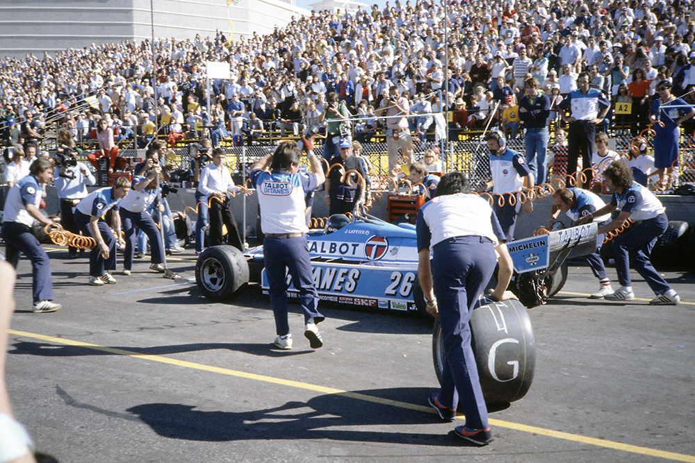 Jacques Laffite (Ligier JS17-Matra) in the pits.