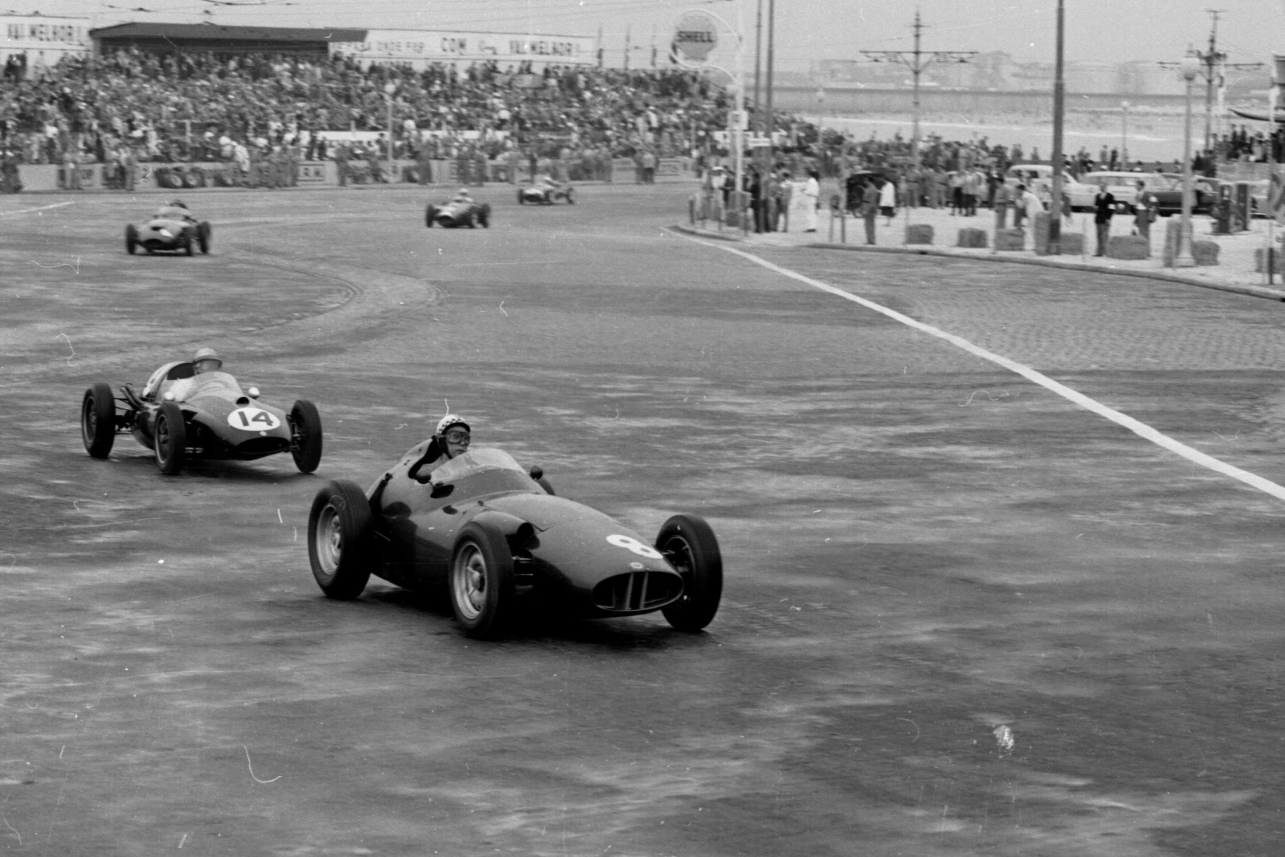 Jean Behra in his BRM P25 leads Jack Brabham driving a Cooper T45-Climax.