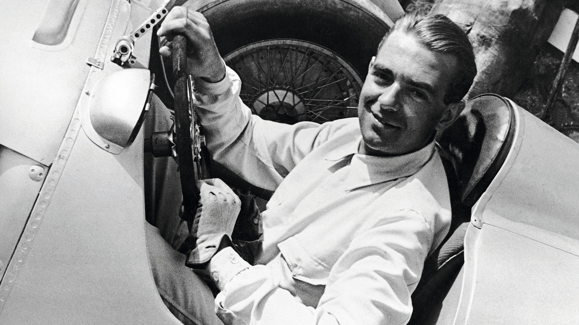 Bernd Rosemeyer in the cockpit of his car in 1936