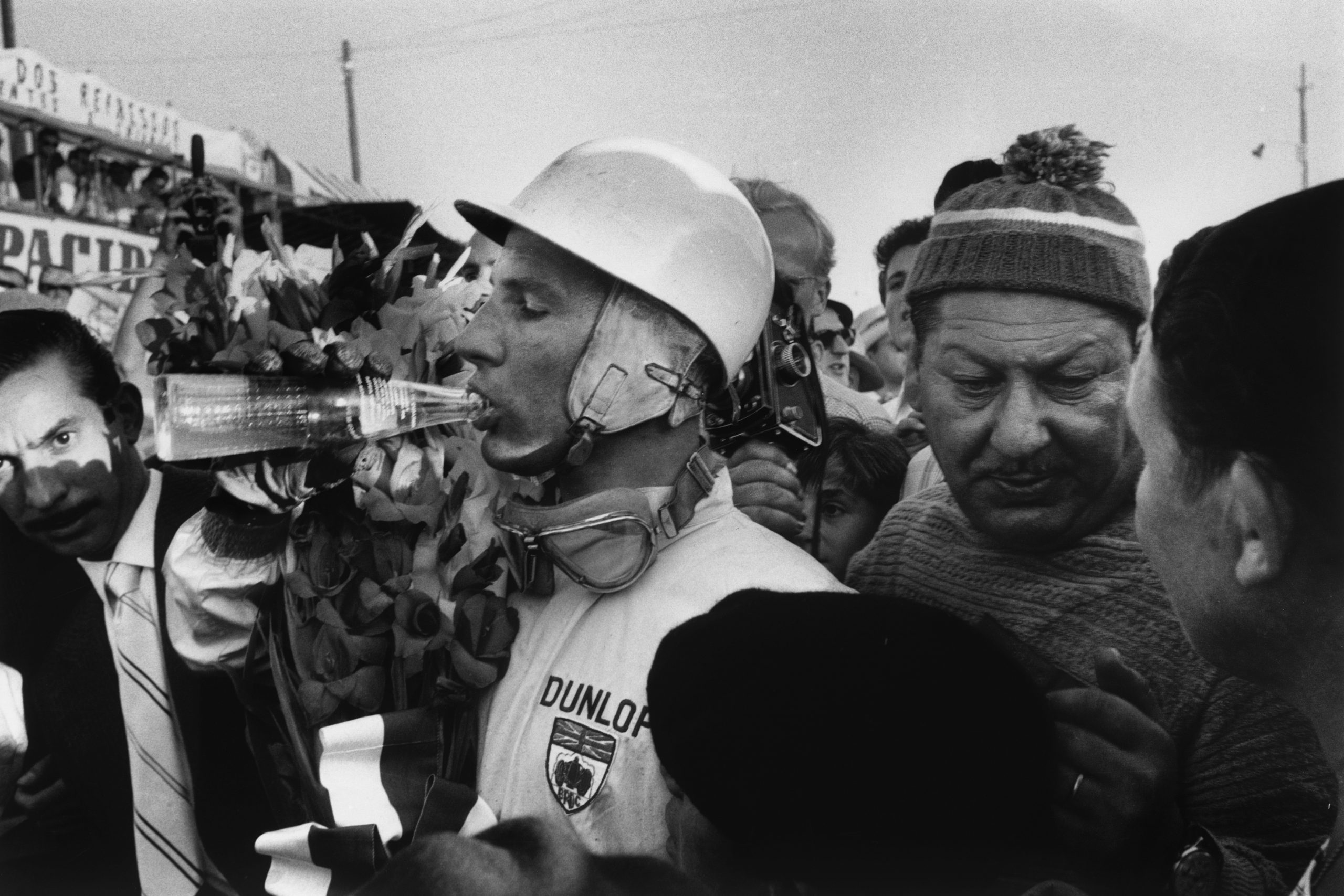 Stirling Moss celebrates with after winning.