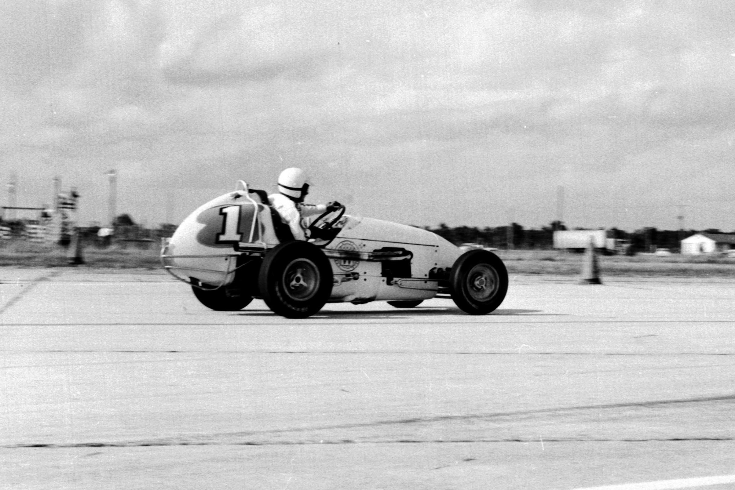 Rodger Ward pushing his Kurtis-Kraft Offenhauser.