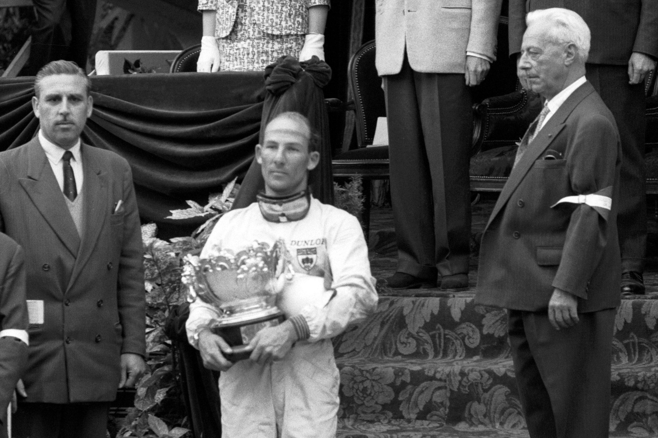 Race winner Stirling Moss on the podium.