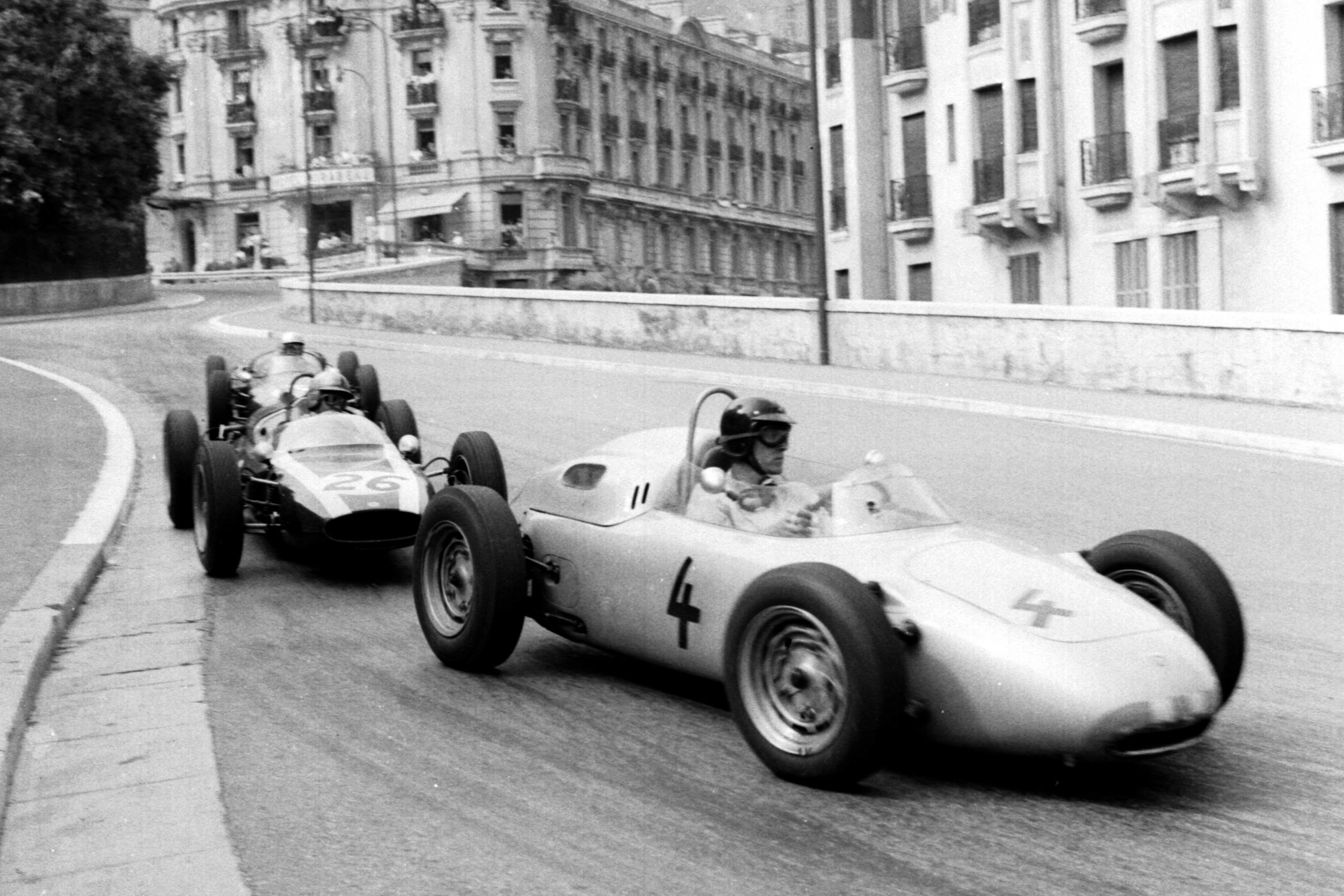 Dan Gurney in a Porsche 718 holds off Bruce McLaren in a Cooper T55 Climax into Station Hairpin.