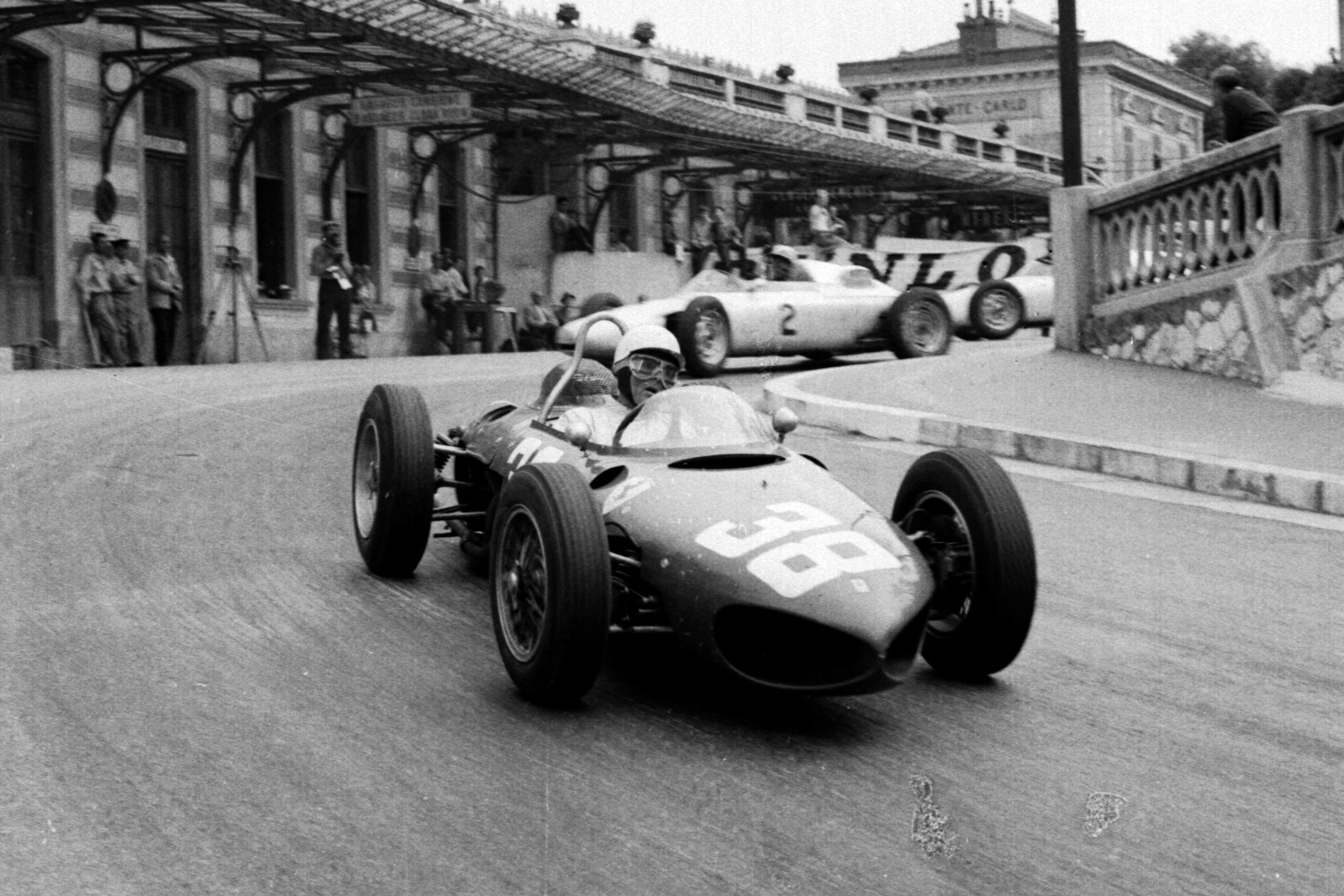 Phil Hill in his Ferrari 156 leads Jo Bonnier's Porsche 787 out of Station Hairpin.