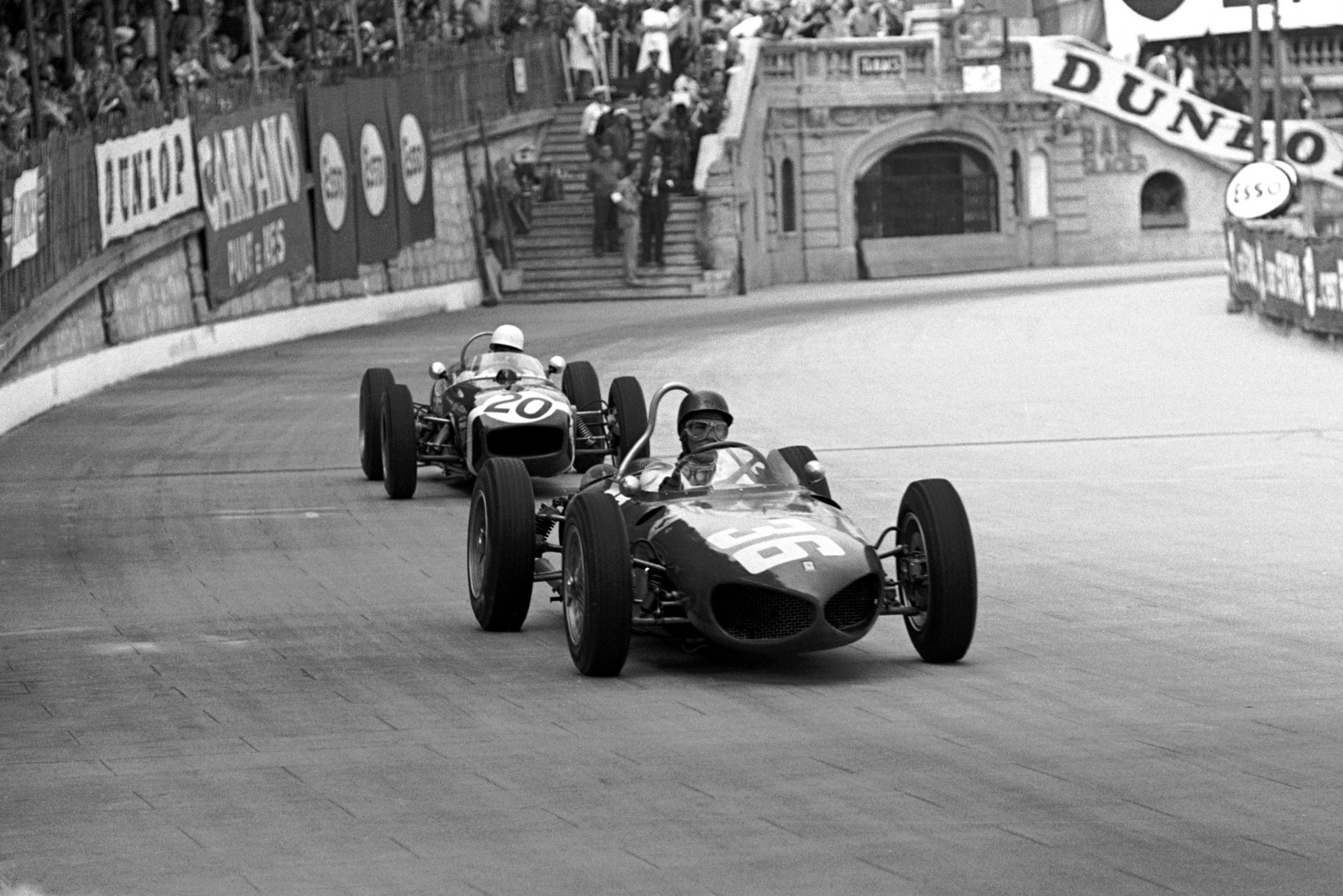 Second place finisher Richie Ginther holds off eventual winner Stirling Moss.