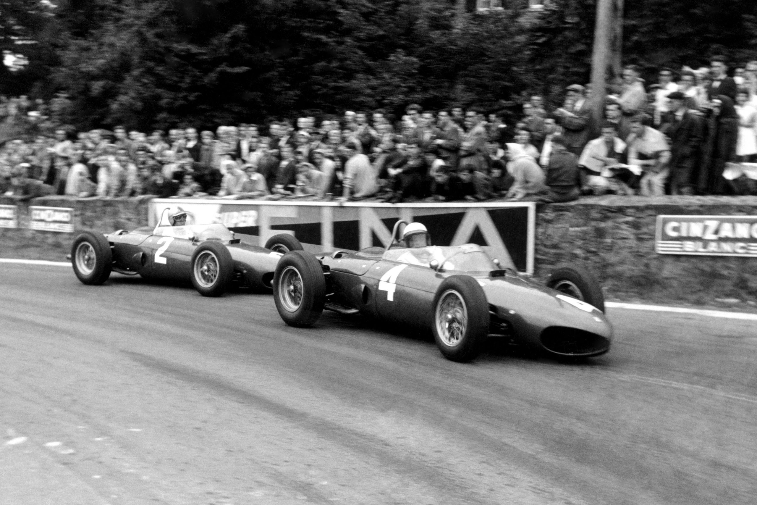 Phil Hill leads Wolfgang von Trips (Ferrari 156) into La Source Hairpin. They finished in 1st and 2nd respectively.