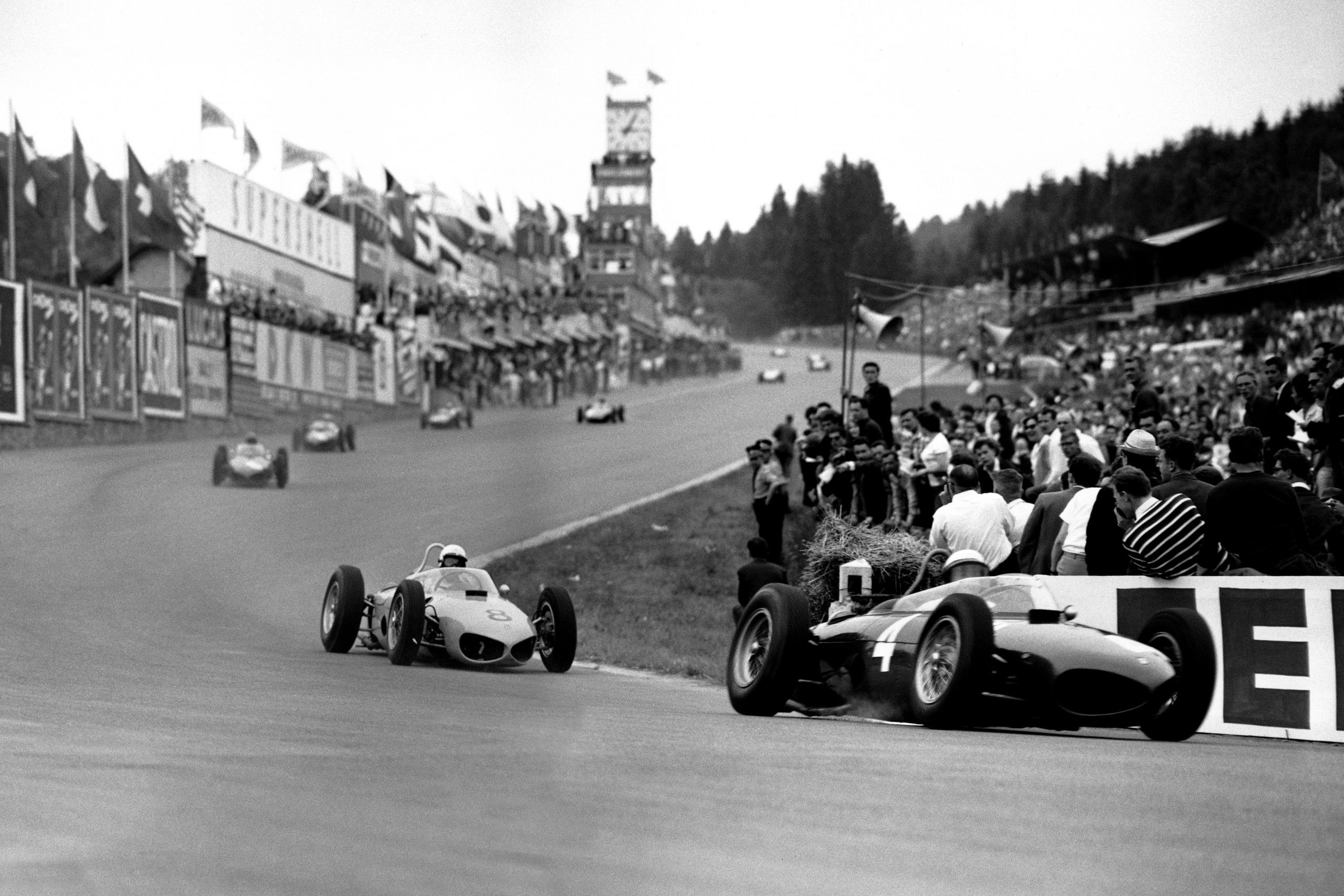 Phil Hill leads Olivier Gendebien, both in Ferrari 156s.