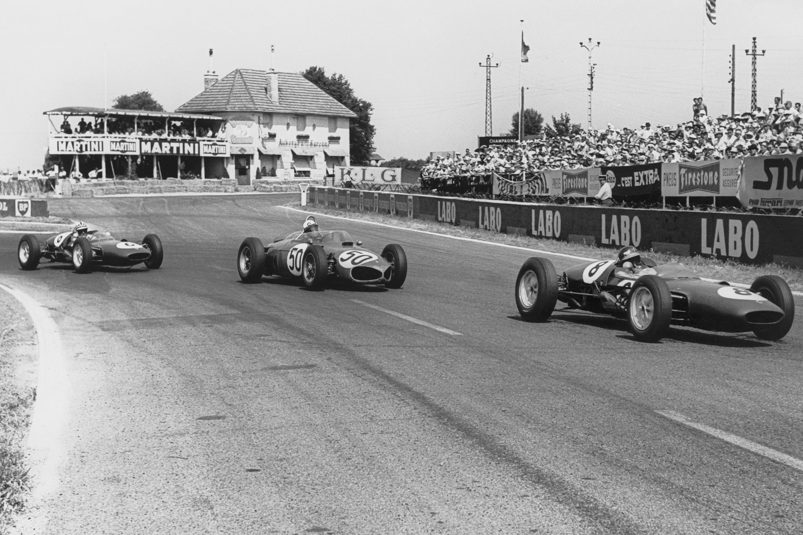 Jim Clark in a Lotus 21-Climax leads Giancarlo Baghetti in his Ferrari Dino 156 and Innes Ireland in a Lotus 21-Climax.