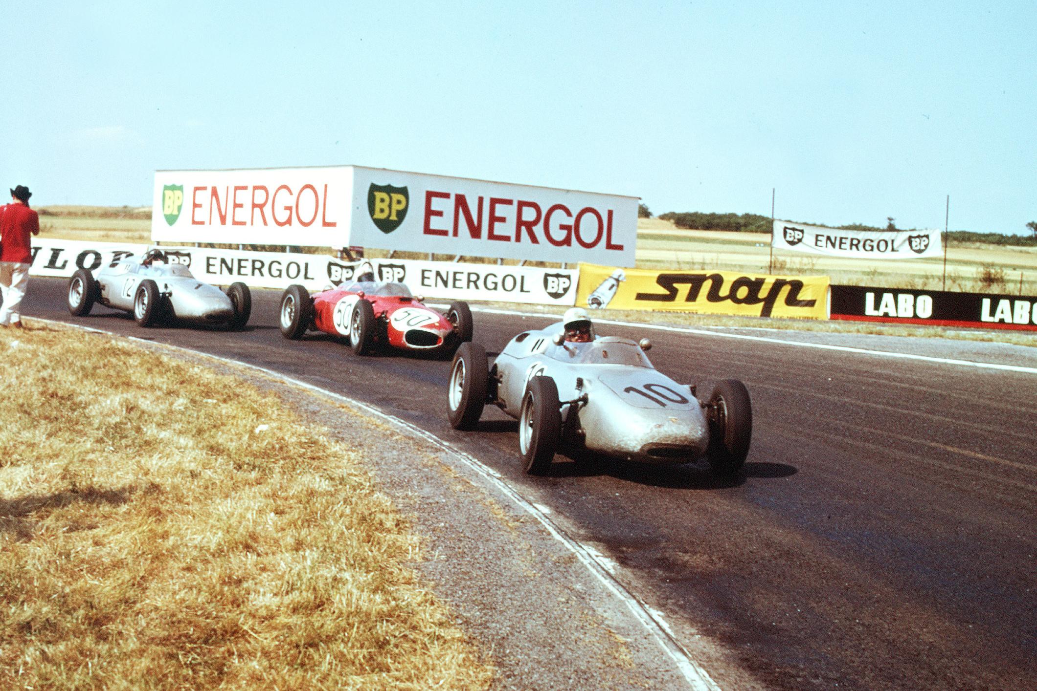 Jo Bonnier in a Porsche 718 leads Giancarlo Baghetti driving a Ferrari Dino 156 and Dan Gurney also in a Porsche 718.