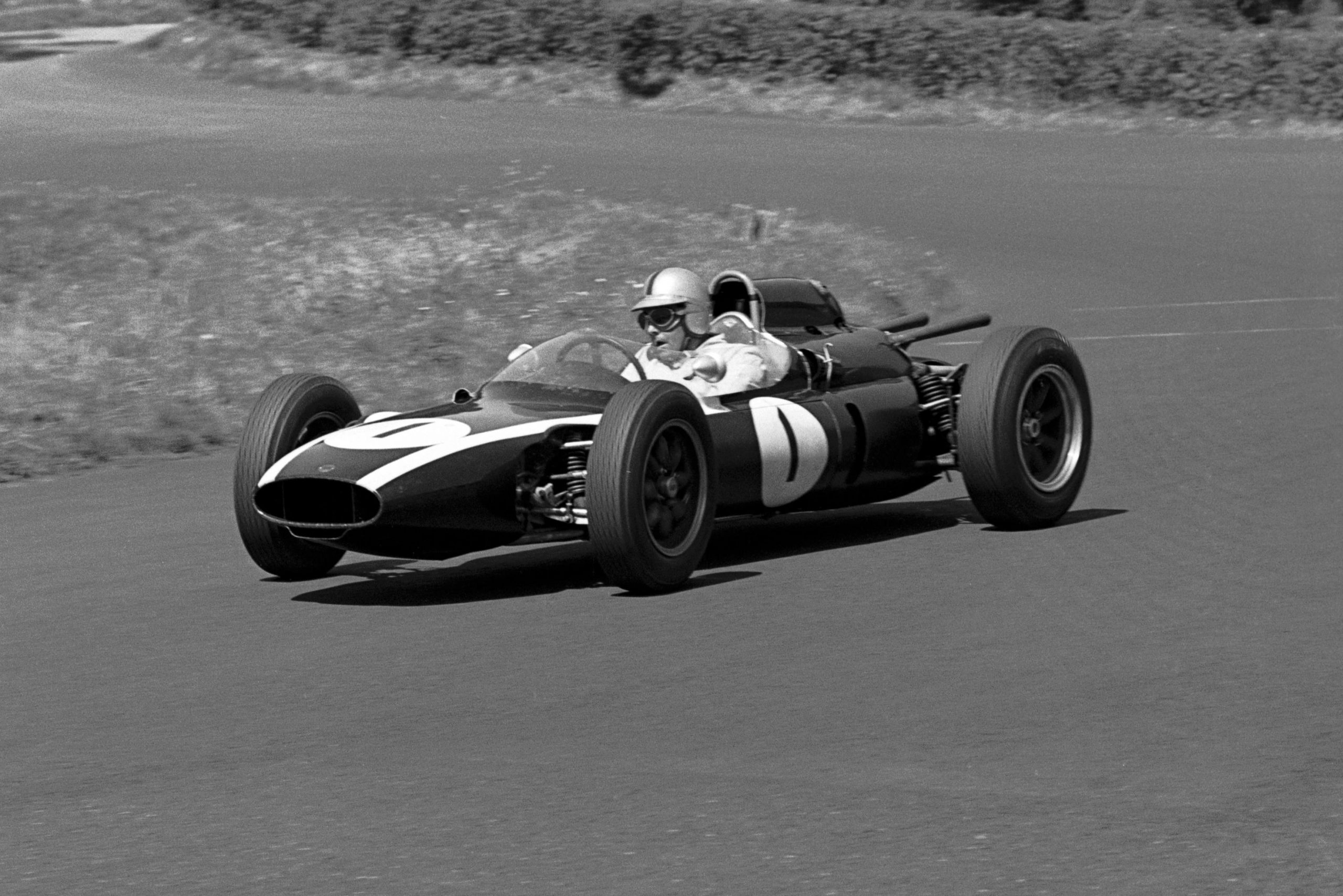 Jack Brabham in the Cooper T58, which spun out on the first lap when his throttle jammed.
