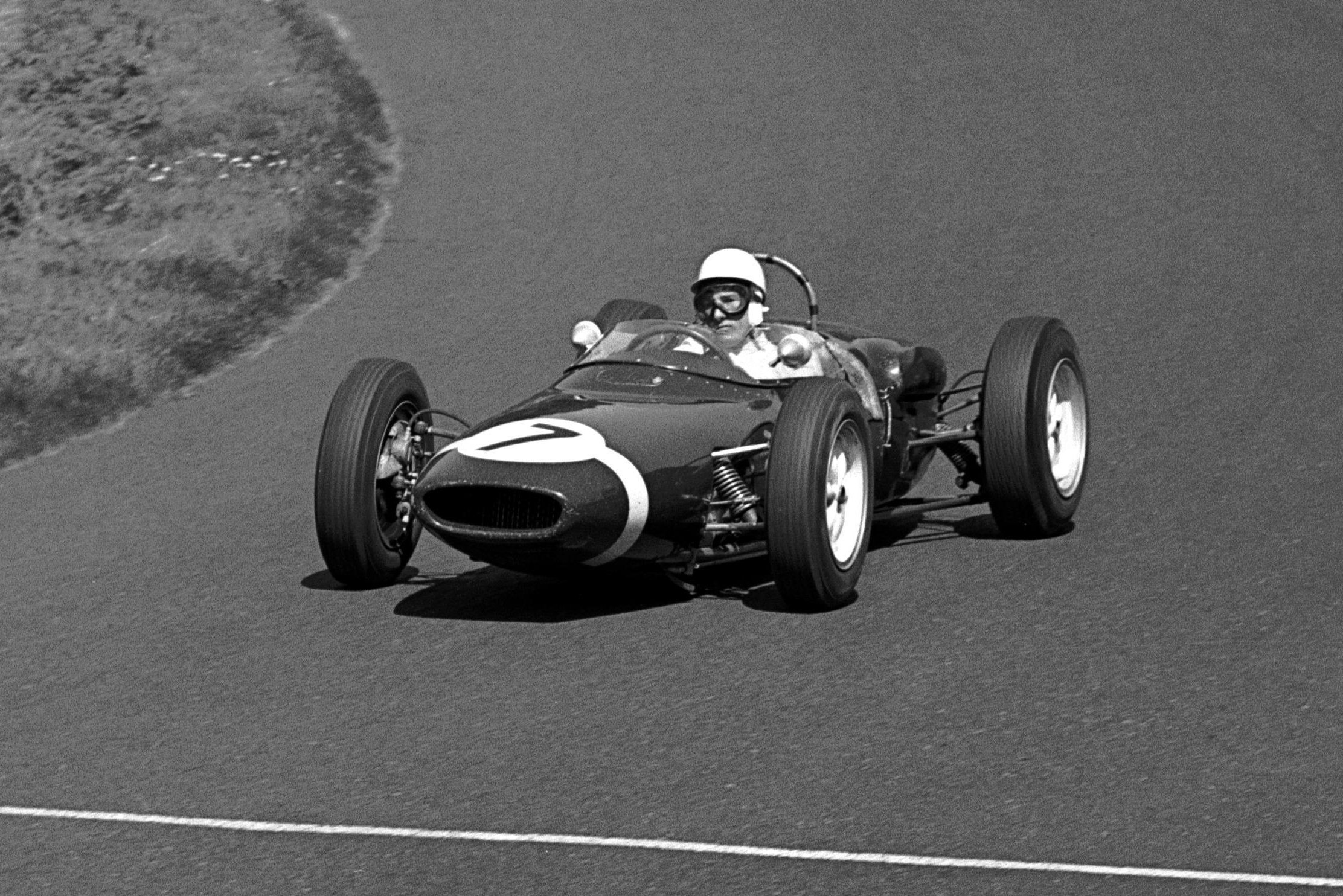 Race winner Stirling Moss wiht his Lotus 18/21 dominated the race.