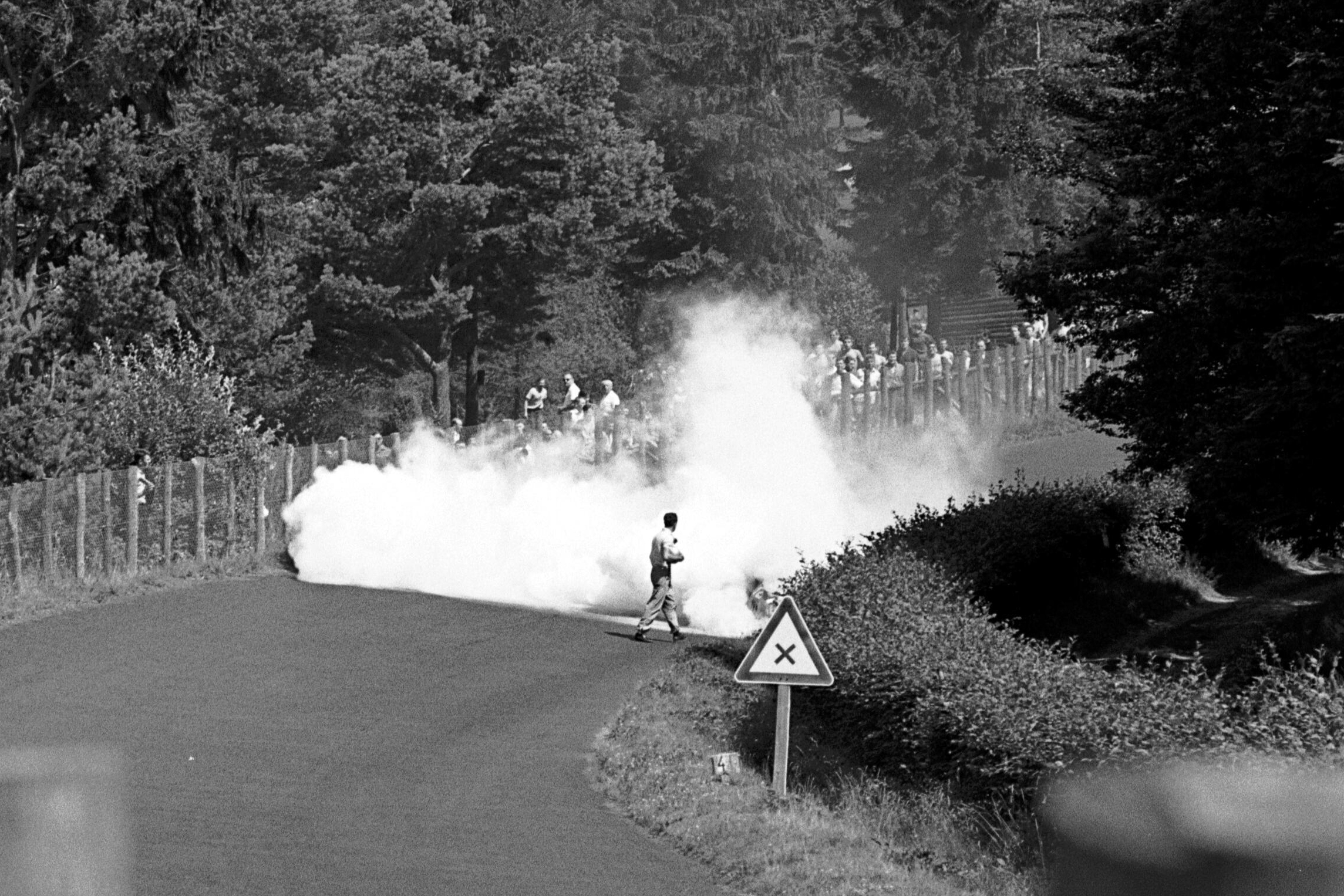 Innes Ireland's Lotus 21 sets itself on fire.