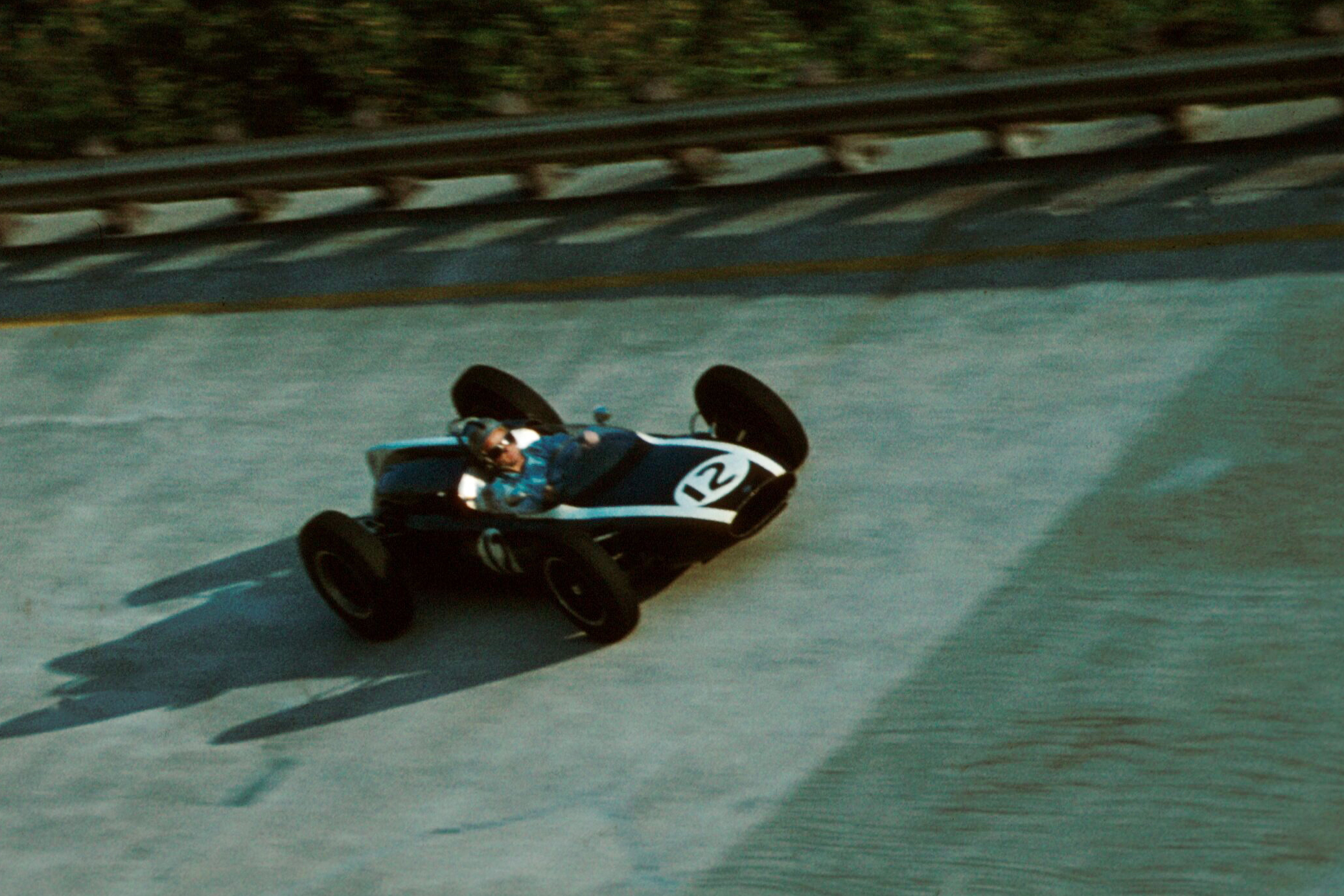 Bruce Mclaren drives his Cooper T55 around the banking.
