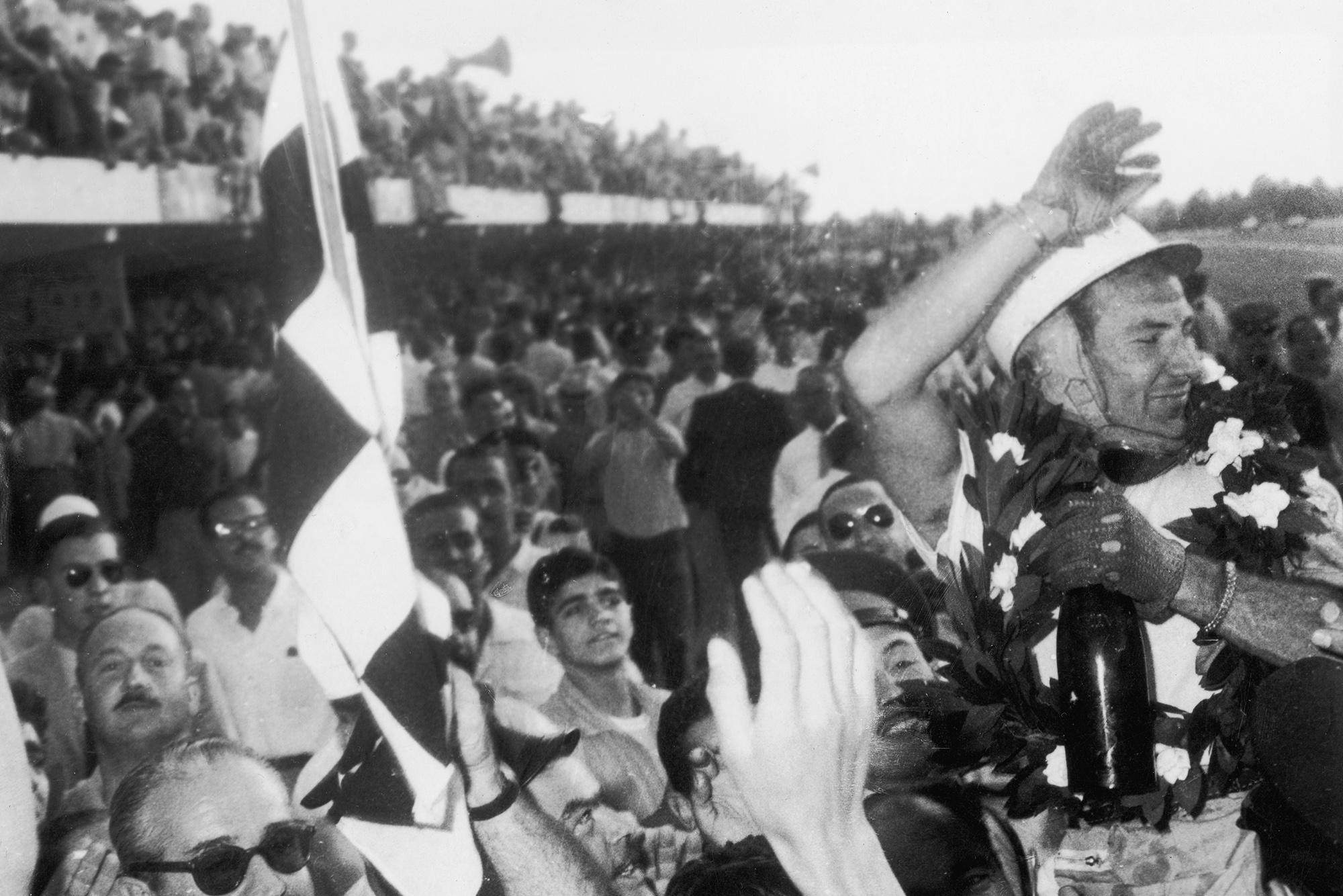 Stirling Moss celebrates winning the 1958 Argentine Grand Prix