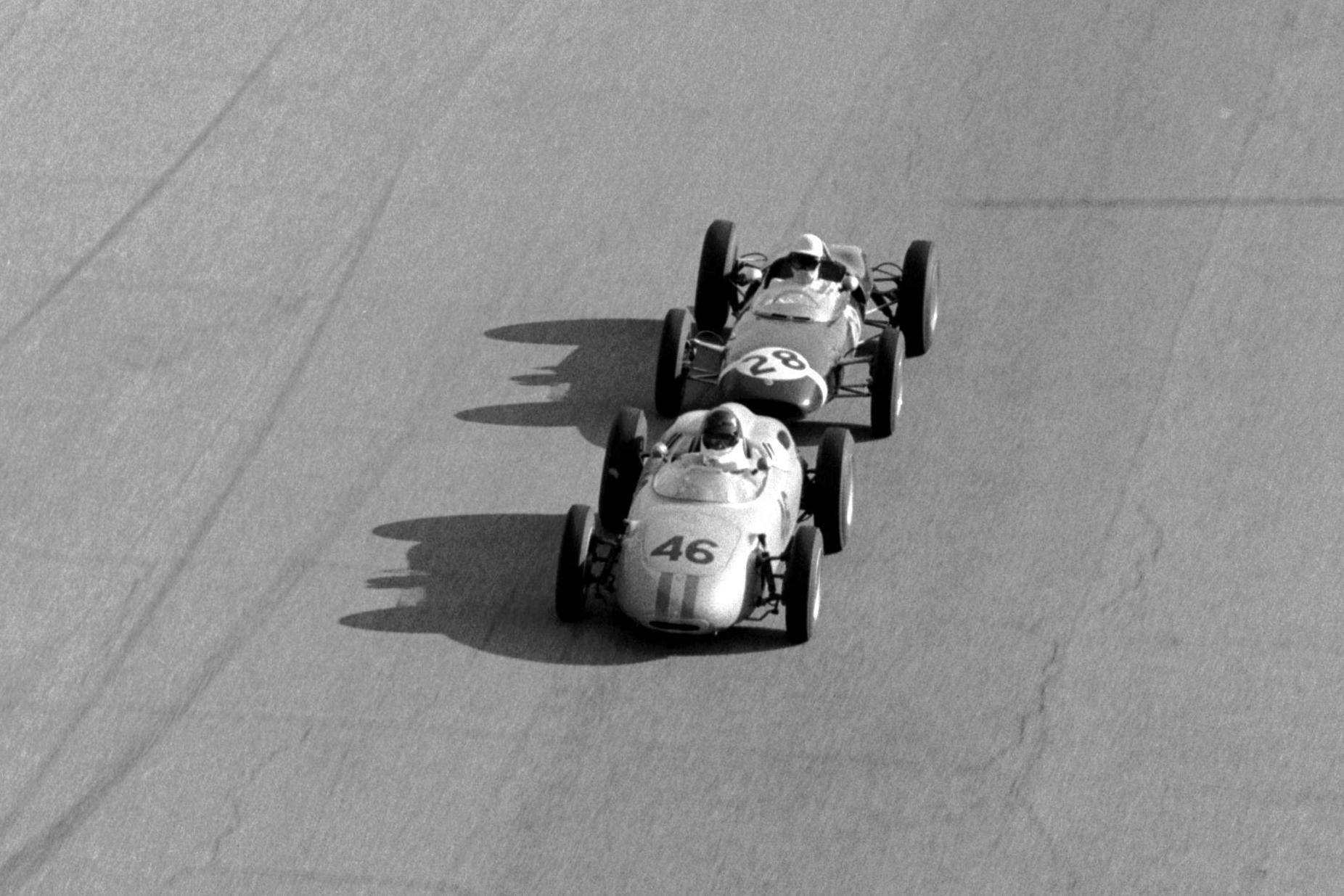 Dan Gurney in a Porsche 718 leads Stirling Moss.